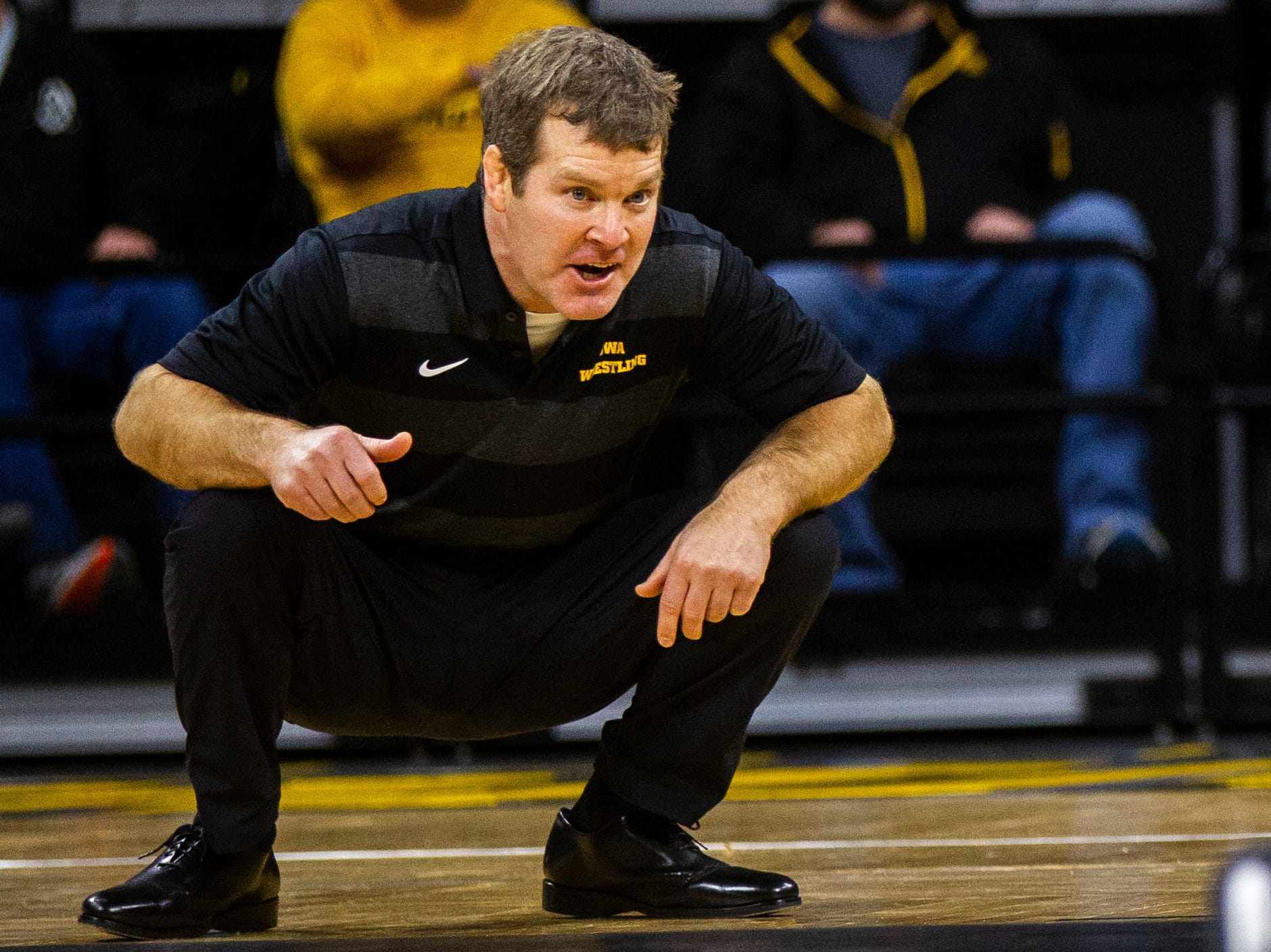 Iowa head coach Tom Brands calls out during a NCAA Cy-Hawk series wrestling dual on Saturday, Dec. 1, 2018, at Carver-Hawkeye Arena in Iowa City.