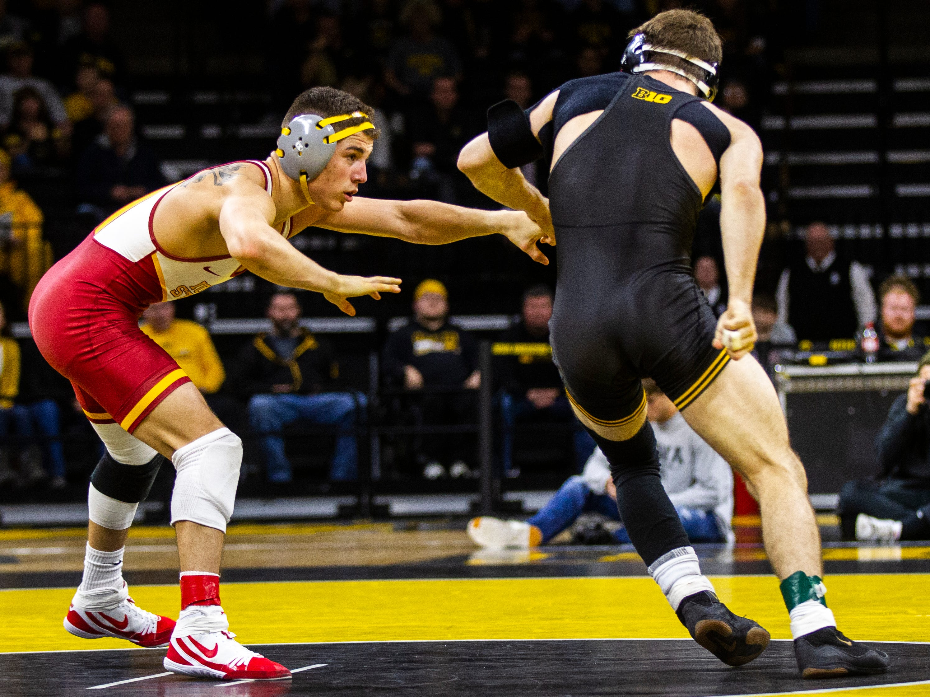 Iowa's Austin DeSanto, right, gets an escape while wrestling Iowa State's Austin Gomez at 133 during a NCAA Cy-Hawk series wrestling dual on Saturday, Dec. 1, 2018, at Carver-Hawkeye Arena in Iowa City.
