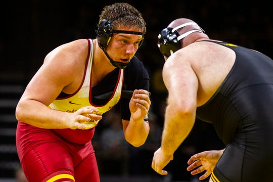 Iowa State's Gannon Gremmel, left, wrestles Iowa's Sam Stoll at 285 during a NCAA Cy-Hawk series wrestling dual on Saturday, Dec. 1, 2018, at Carver-Hawkeye Arena in Iowa City.