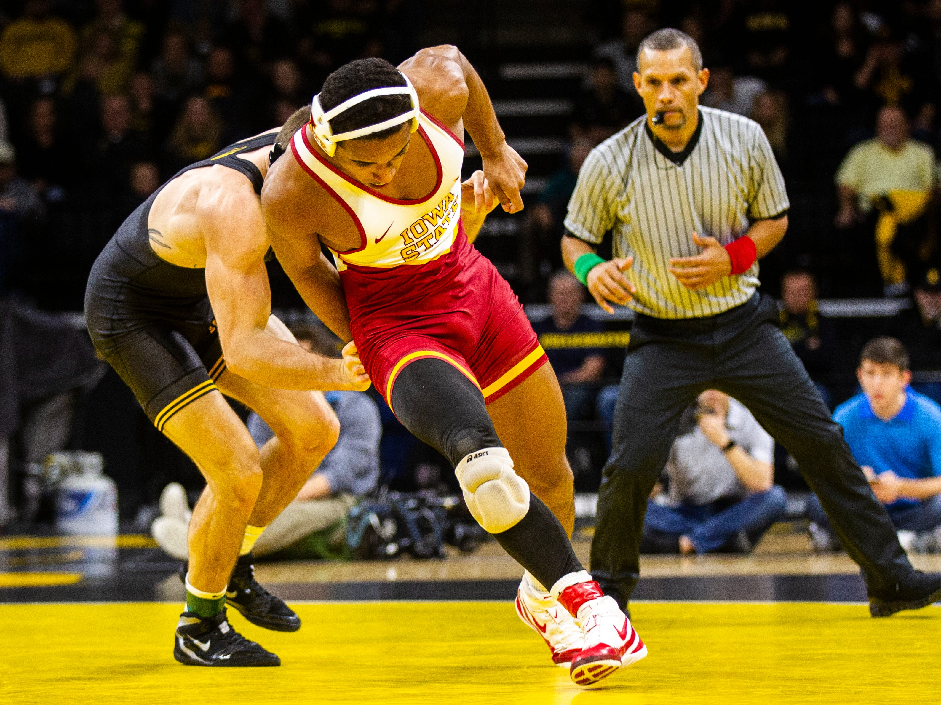 Iowa State's Marcus Coleman, right, gets an escape while wrestling Iowa's Myles Wilson at 174 during a NCAA Cy-Hawk series wrestling dual on Saturday, Dec. 1, 2018, at Carver-Hawkeye Arena in Iowa City.