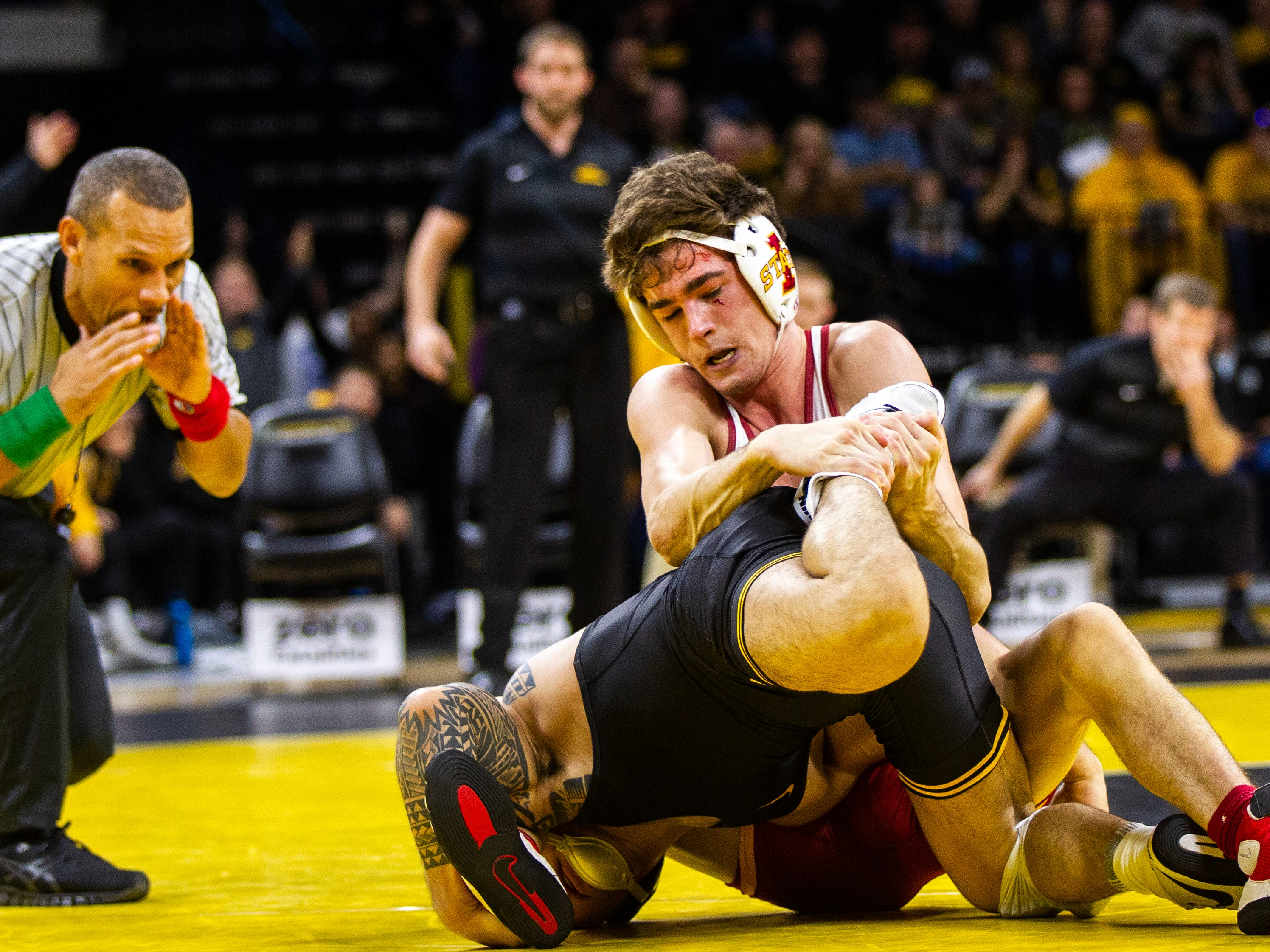 Iowa State's Jarrett Degen, top, wrestles Pat Lugo at 149 during a NCAA Cy-Hawk series wrestling dual on Saturday, Dec. 1, 2018, at Carver-Hawkeye Arena in Iowa City.