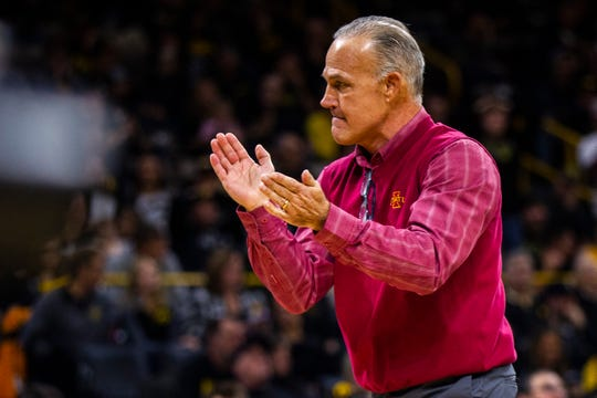 Iowa State head coach Kevin Dresser claps during a NCAA Cy-Hawk series wrestling dual on Saturday, Dec. 1, 2018, at Carver-Hawkeye Arena in Iowa City.