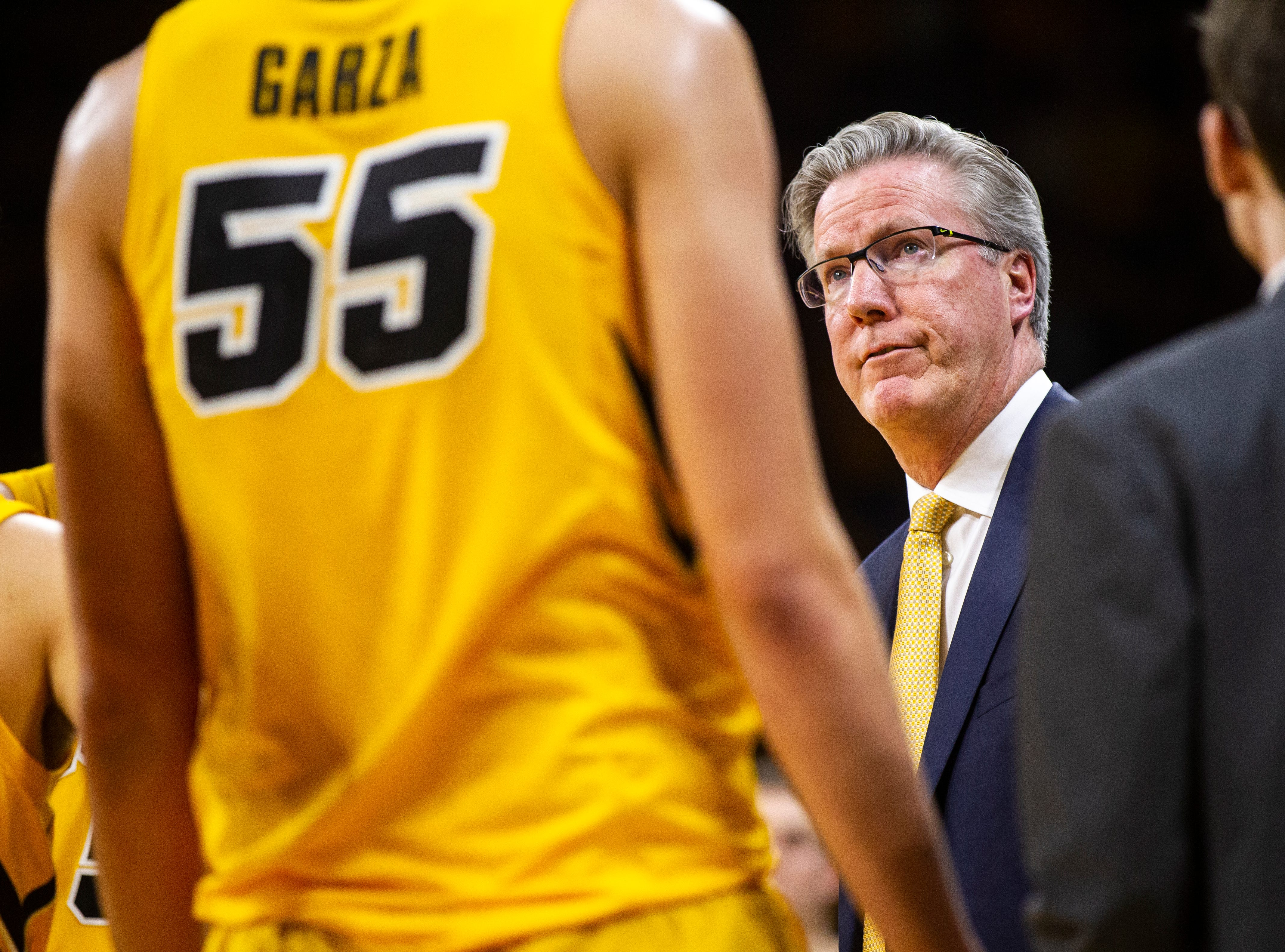 Iowa men's basketball head coach Fran McCaffery looks up at the scoreboard during a NCAA Big Ten Conference men's basketball game on Friday, Nov. 30, 2018, at Carver-Hawkeye Arena in Iowa City.