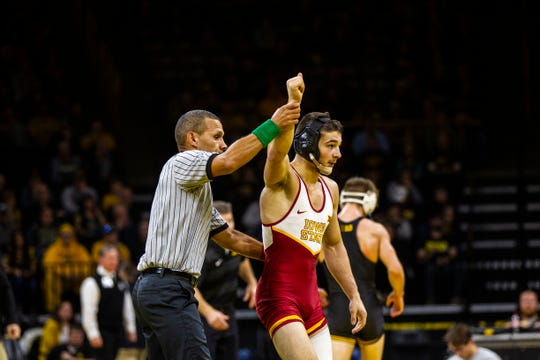 Iowa State's Ian Parker has his hand raised after scoring a decision over Iowa's Max Murin at 141 during a NCAA Cy-Hawk series wrestling dual on Saturday, Dec. 1, 2018, at Carver-Hawkeye Arena in Iowa City.