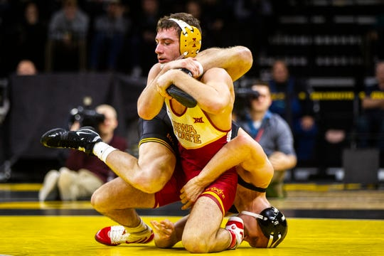 Iowa State's Chase Straw, left, wrestles Iowa's Kaleb Young at 157 during a NCAA Cy-Hawk series wrestling dual on Saturday, Dec. 1, 2018, at Carver-Hawkeye Arena in Iowa City.