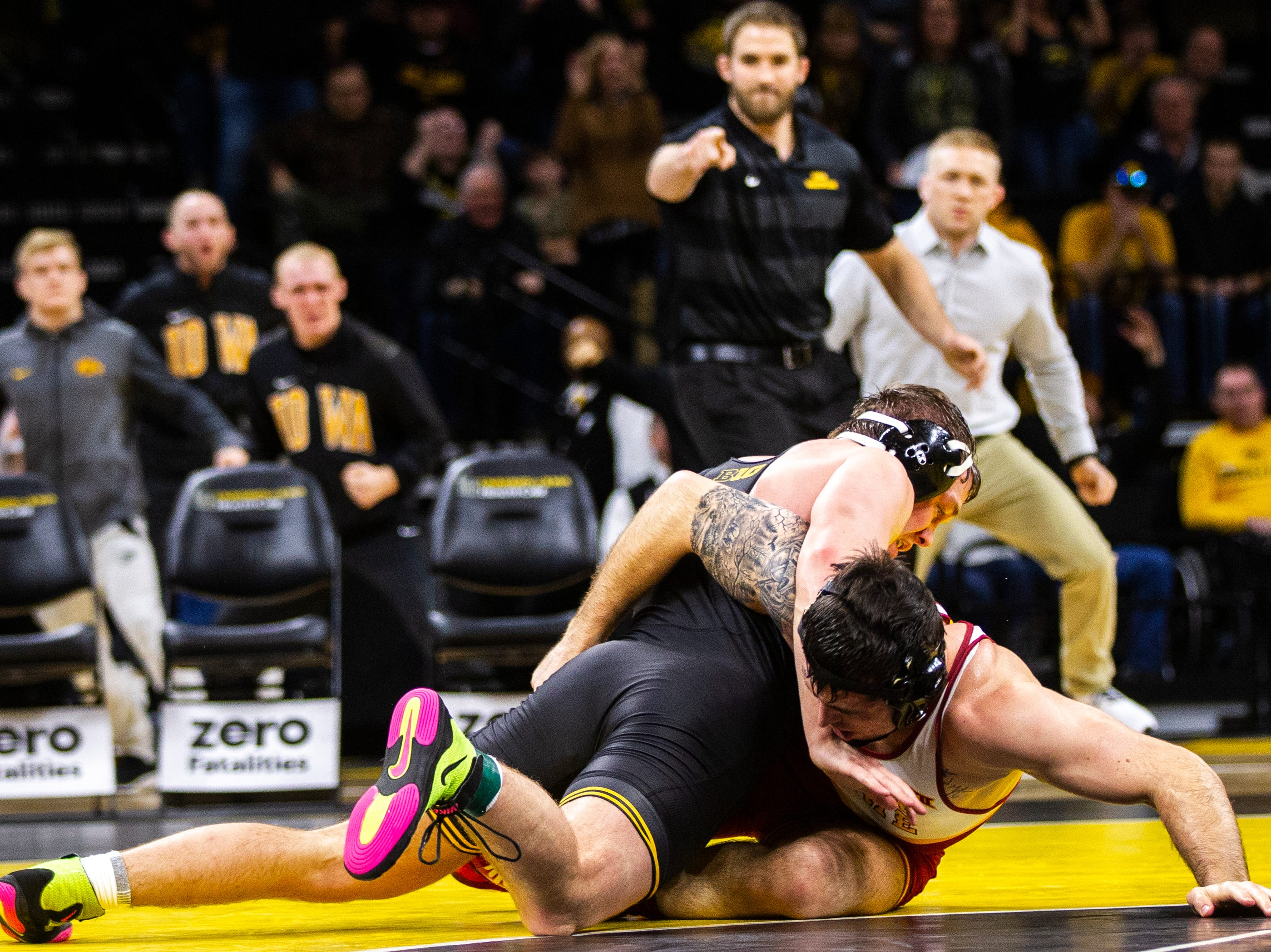 Iowa's Jacob Warner, top, wrestles Iowa State's Willie Miklus at 197 during a NCAA Cy-Hawk series wrestling dual on Saturday, Dec. 1, 2018, at Carver-Hawkeye Arena in Iowa City.