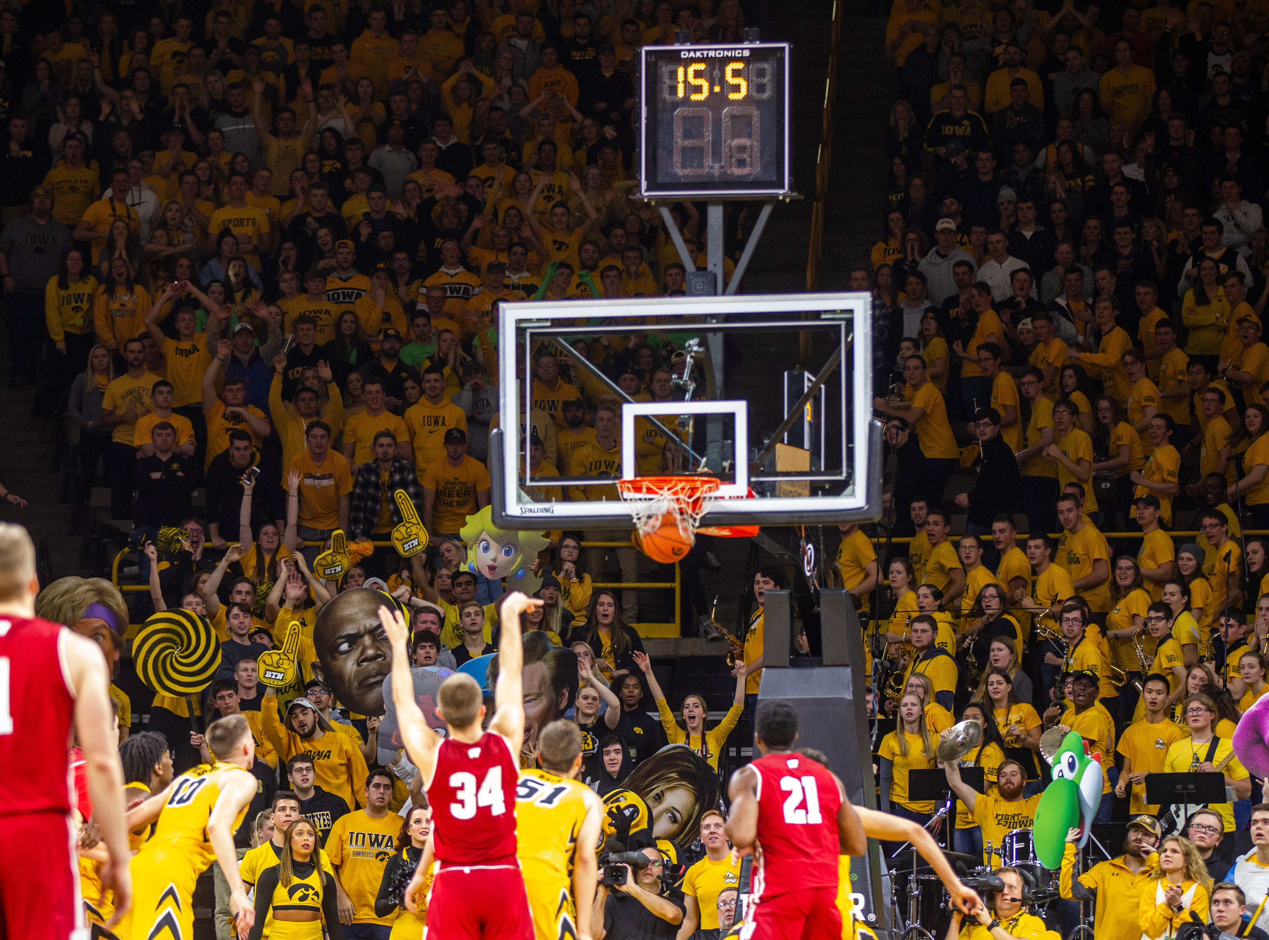 Wisconsin's Brad Davidson (34) makes a free throw while Iowa students attempt to distract him during a NCAA Big Ten Conference men's basketball game on Friday, Nov. 30, 2018, at Carver-Hawkeye Arena in Iowa City.