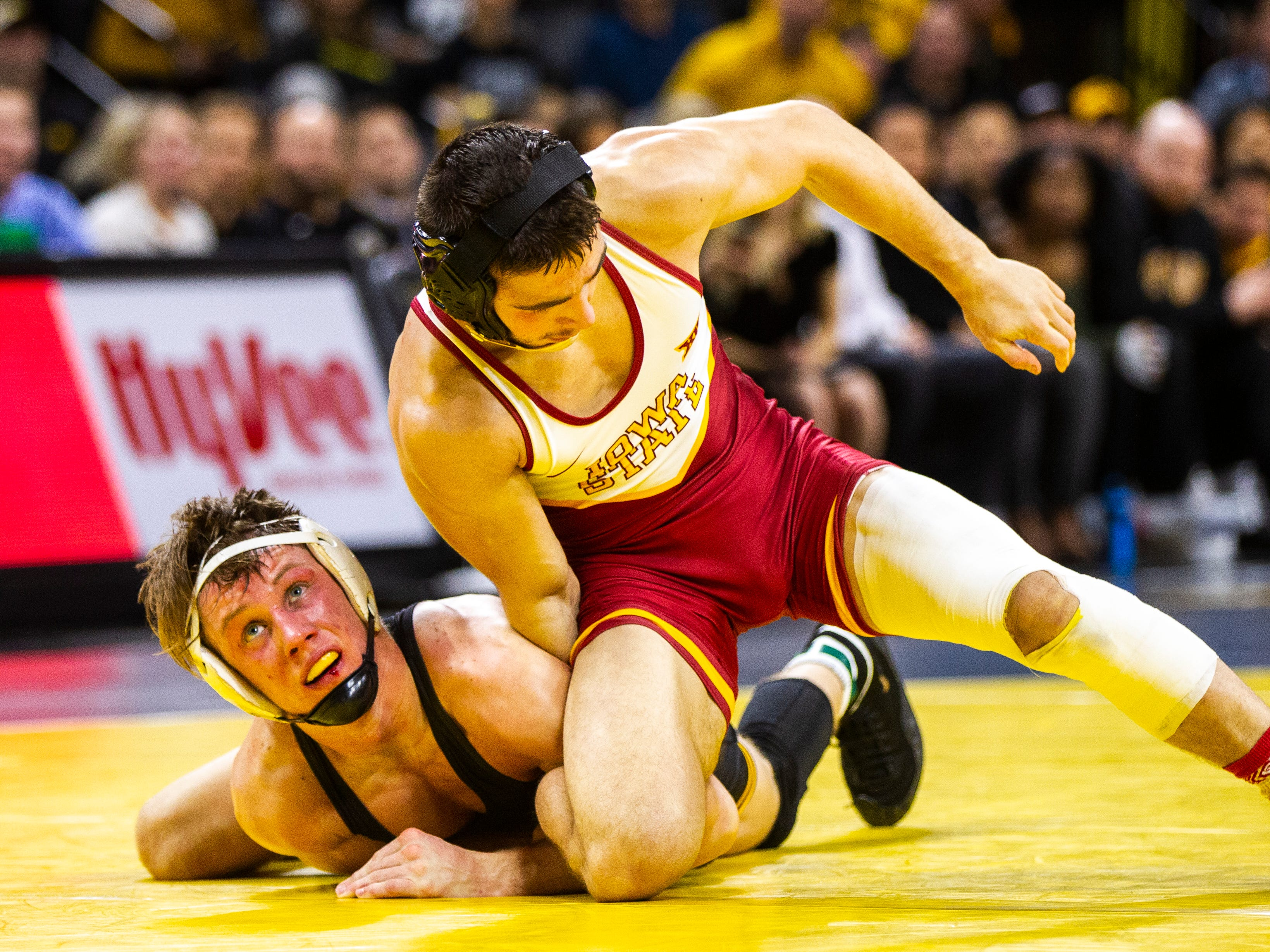 Iowa's Max Murin, left, wrestles Iowa State's Ian Parker at 141 during a NCAA Cy-Hawk series wrestling dual on Saturday, Dec. 1, 2018, at Carver-Hawkeye Arena in Iowa City.