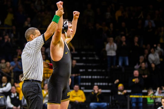 Iowa's Jacob Warner has his arm raised after scoring a decision over Iowa State's Willie Miklus at 197 during a NCAA Cy-Hawk series wrestling dual on Saturday, Dec. 1, 2018, at Carver-Hawkeye Arena in Iowa City.
