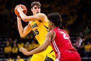 Iowa forward Luka Garza (55) looks to pass during a NCAA Big Ten Conference men's basketball game on Friday, Nov. 30, 2018, at Carver-Hawkeye Arena in Iowa City.