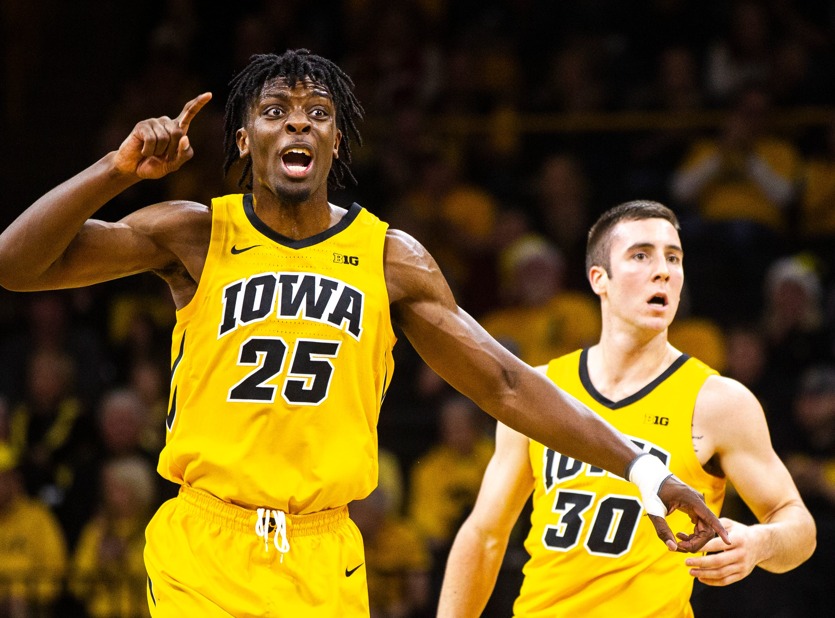 Iowa forward Tyler Cook (25) calls out to teammates during a NCAA Big Ten Conference men's basketball game on Friday, Nov. 30, 2018, at Carver-Hawkeye Arena in Iowa City.