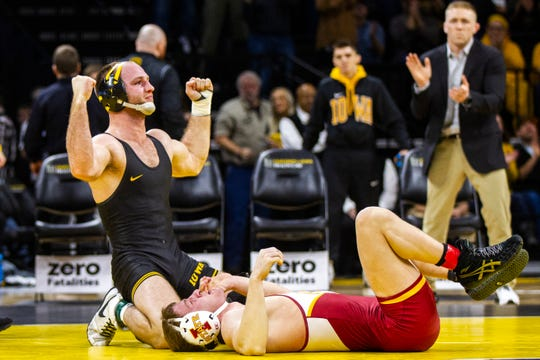 Iowa's Alex Marinelli, left, celebrates after pinning Iowa State's Brady Jennings at 165 during a NCAA Cy-Hawk series wrestling dual on Saturday, Dec. 1, 2018, at Carver-Hawkeye Arena in Iowa City.