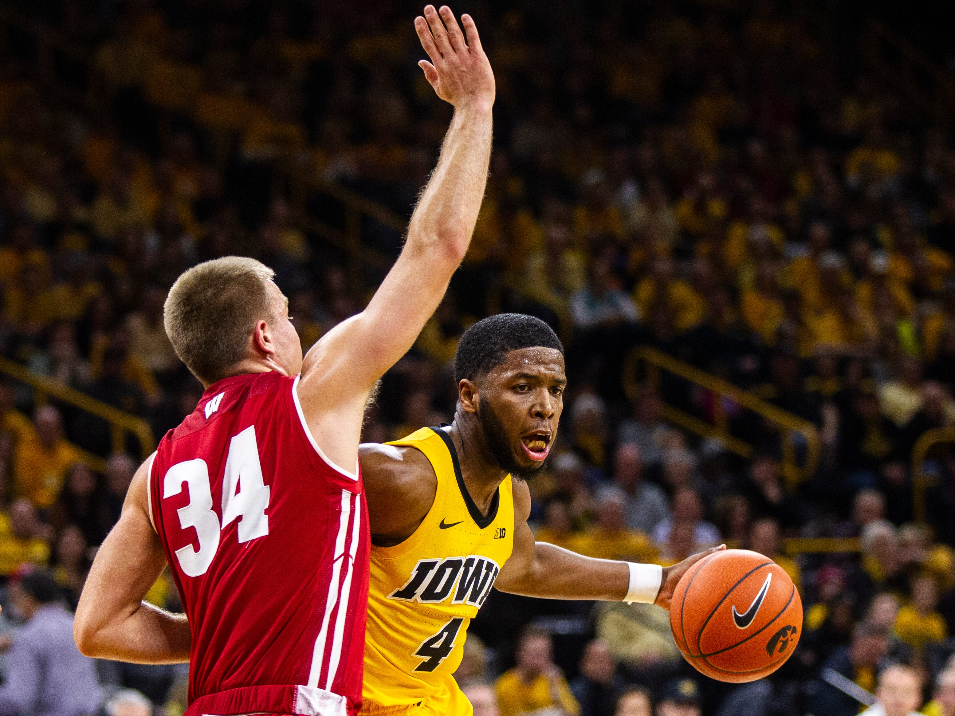 Iowa guard Isaiah Moss (4) drives to the hoop past Wisconsin's Brad Davidson (34) during a NCAA Big Ten Conference men's basketball game on Friday, Nov. 30, 2018, at Carver-Hawkeye Arena in Iowa City.