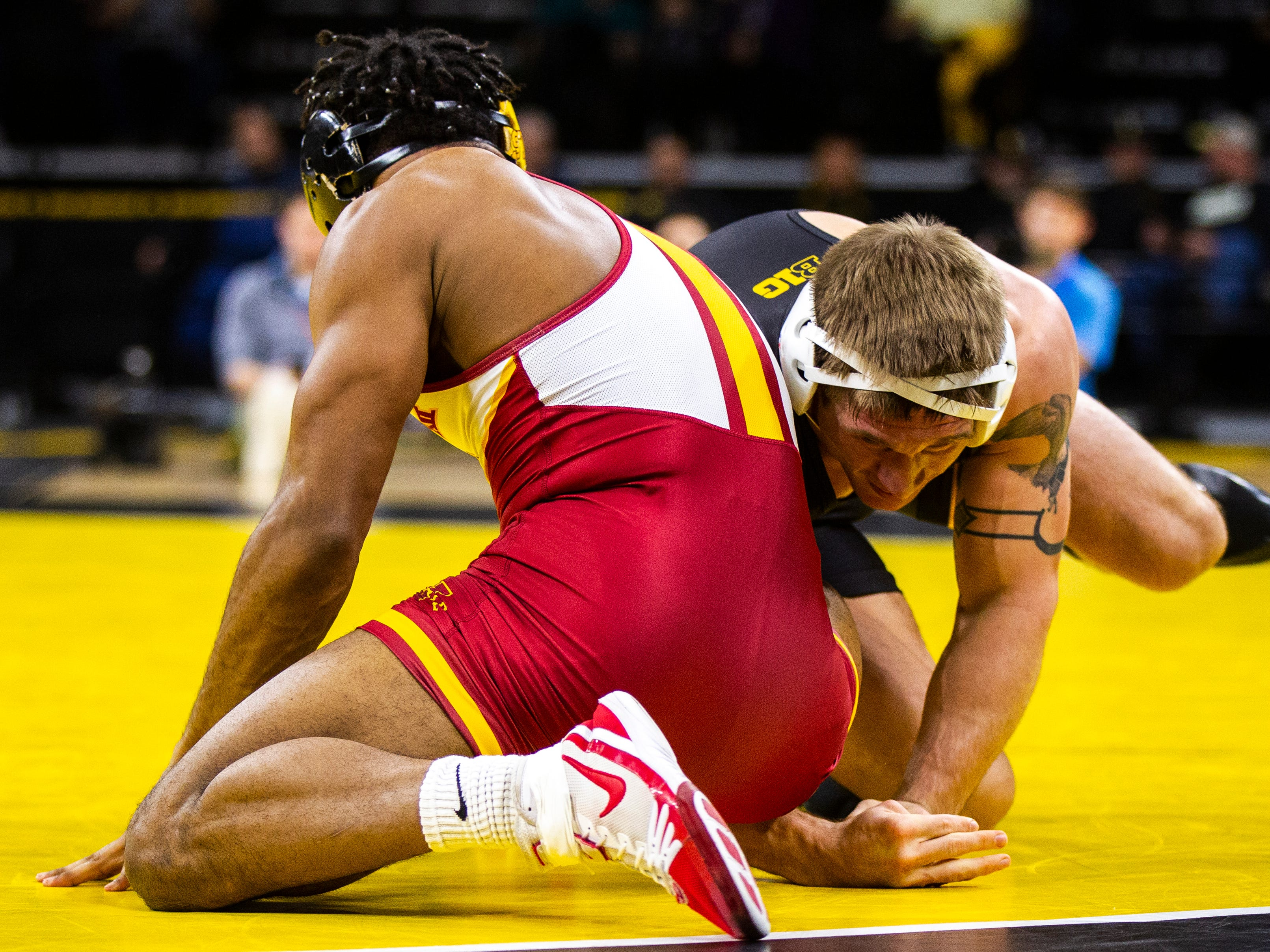 Iowa's Cash Wilcke, right, wrestles Iowa State's Sam Colbray at 184 during a NCAA Cy-Hawk series wrestling dual on Saturday, Dec. 1, 2018, at Carver-Hawkeye Arena in Iowa City.
