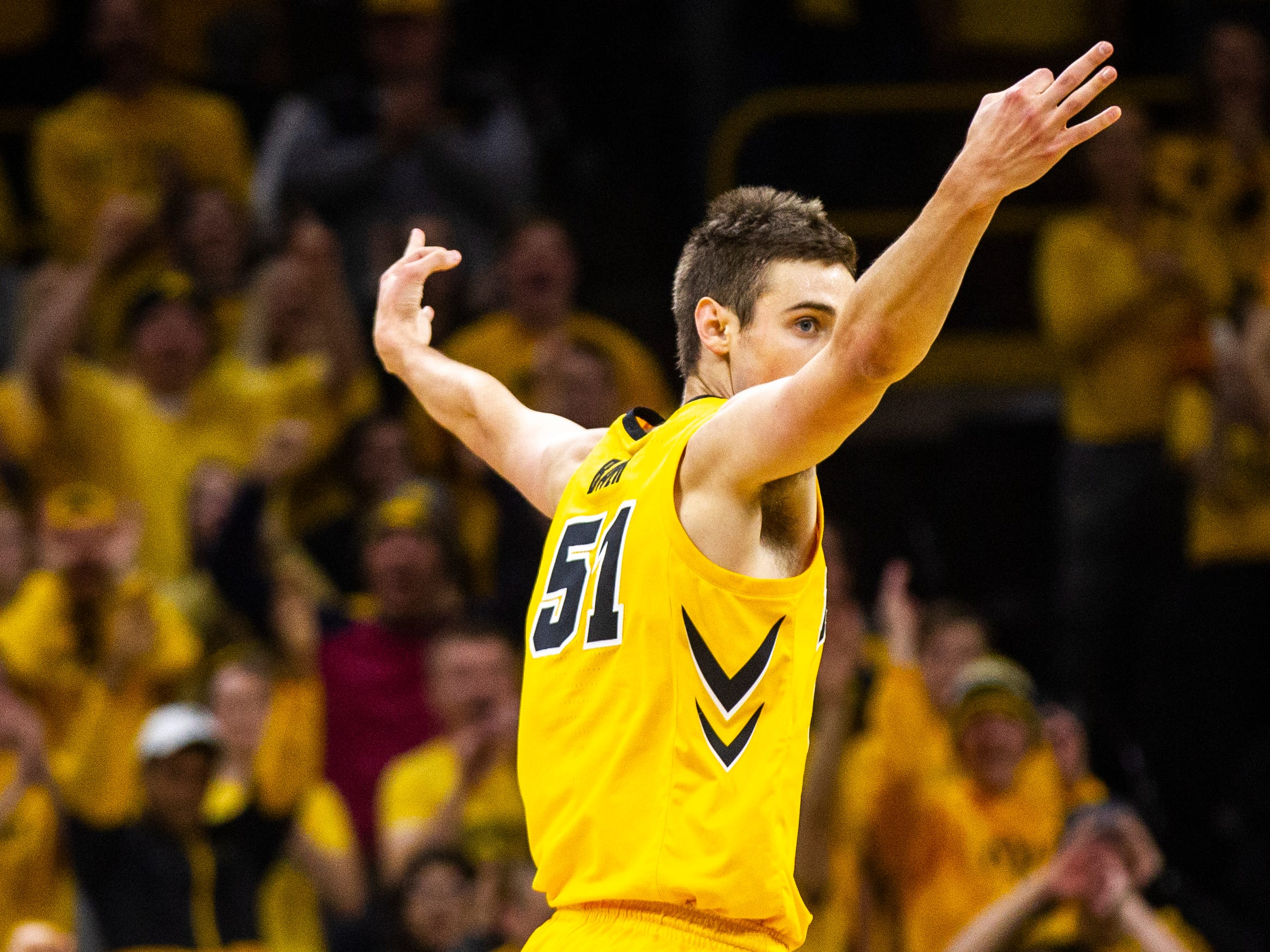 Iowa forward Nicholas Baer (51) celebrates after making a 3-point basket during a NCAA Big Ten Conference men's basketball game on Friday, Nov. 30, 2018, at Carver-Hawkeye Arena in Iowa City.