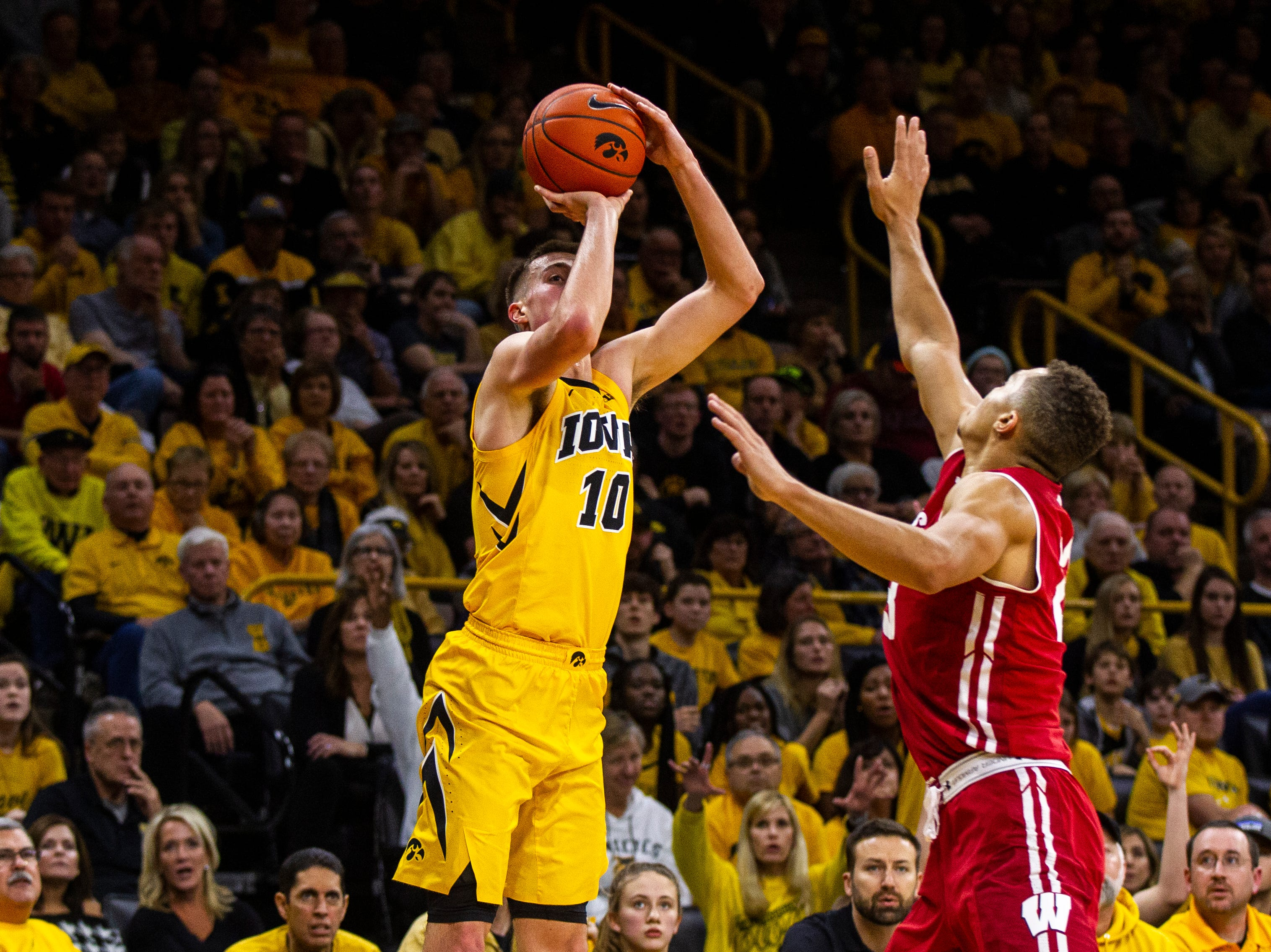 Iowa guard Joe Wieskamp (10) attempts a 3-point basket during a NCAA Big Ten Conference men's basketball game on Friday, Nov. 30, 2018, at Carver-Hawkeye Arena in Iowa City.