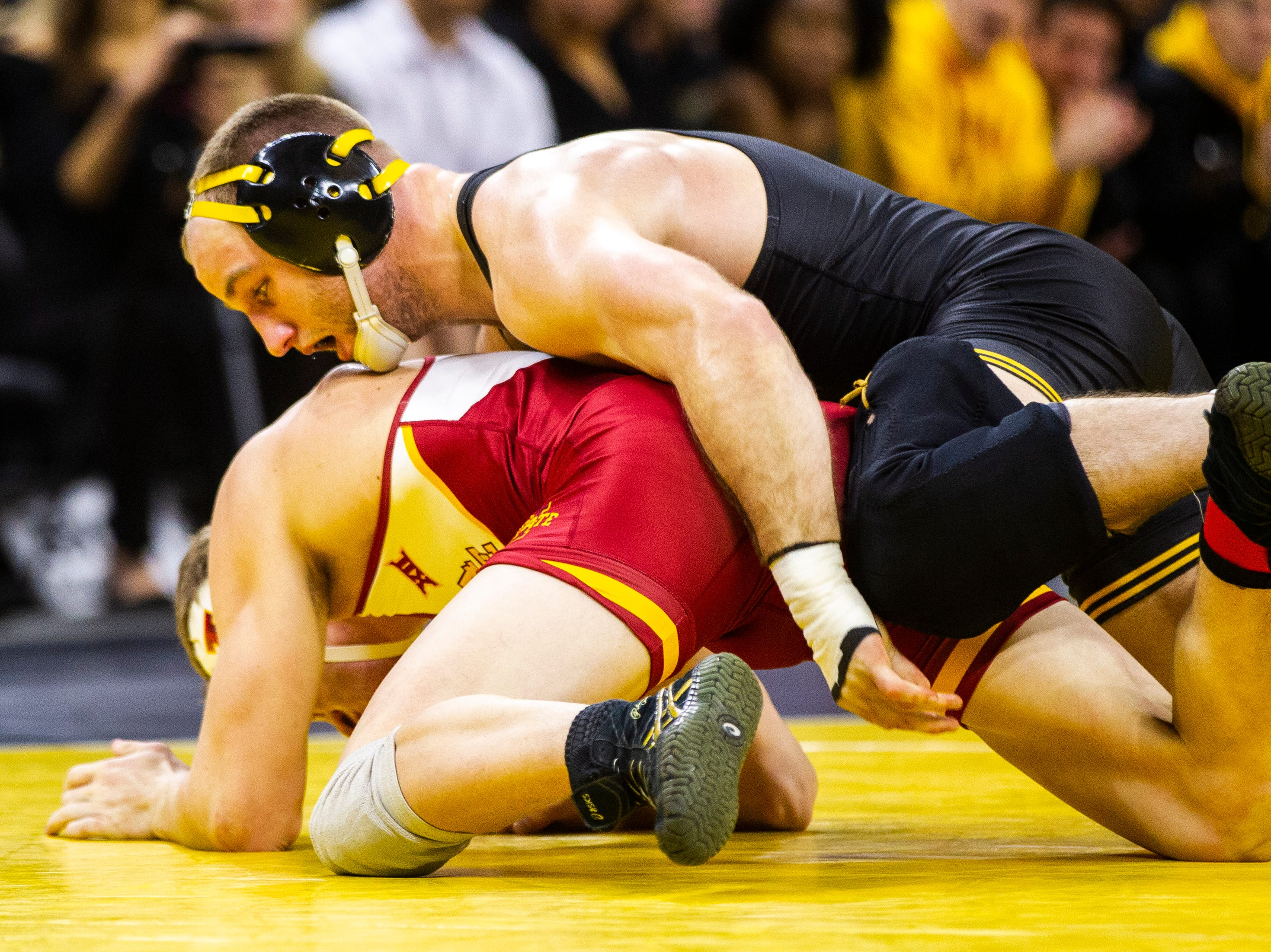 Iowa's Alex Marinelli, right, wrestles Iowa State's Brady Jennings at 165 during a NCAA Cy-Hawk series wrestling dual on Saturday, Dec. 1, 2018, at Carver-Hawkeye Arena in Iowa City.