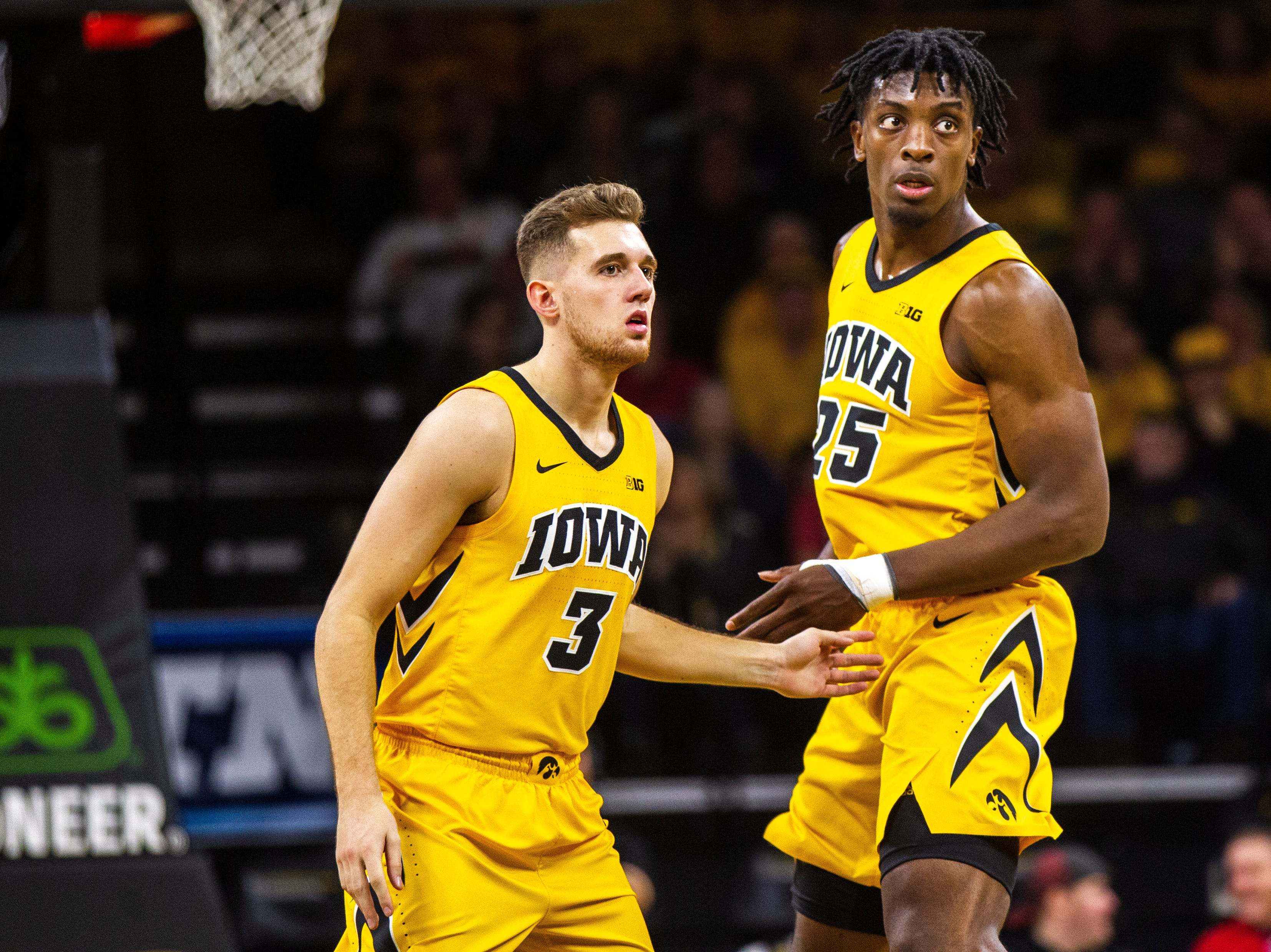 Iowa guard Jordan Bohannon (3) high-fives Iowa forward Tyler Cook (25) during a NCAA Big Ten Conference men's basketball game on Friday, Nov. 30, 2018, at Carver-Hawkeye Arena in Iowa City.
