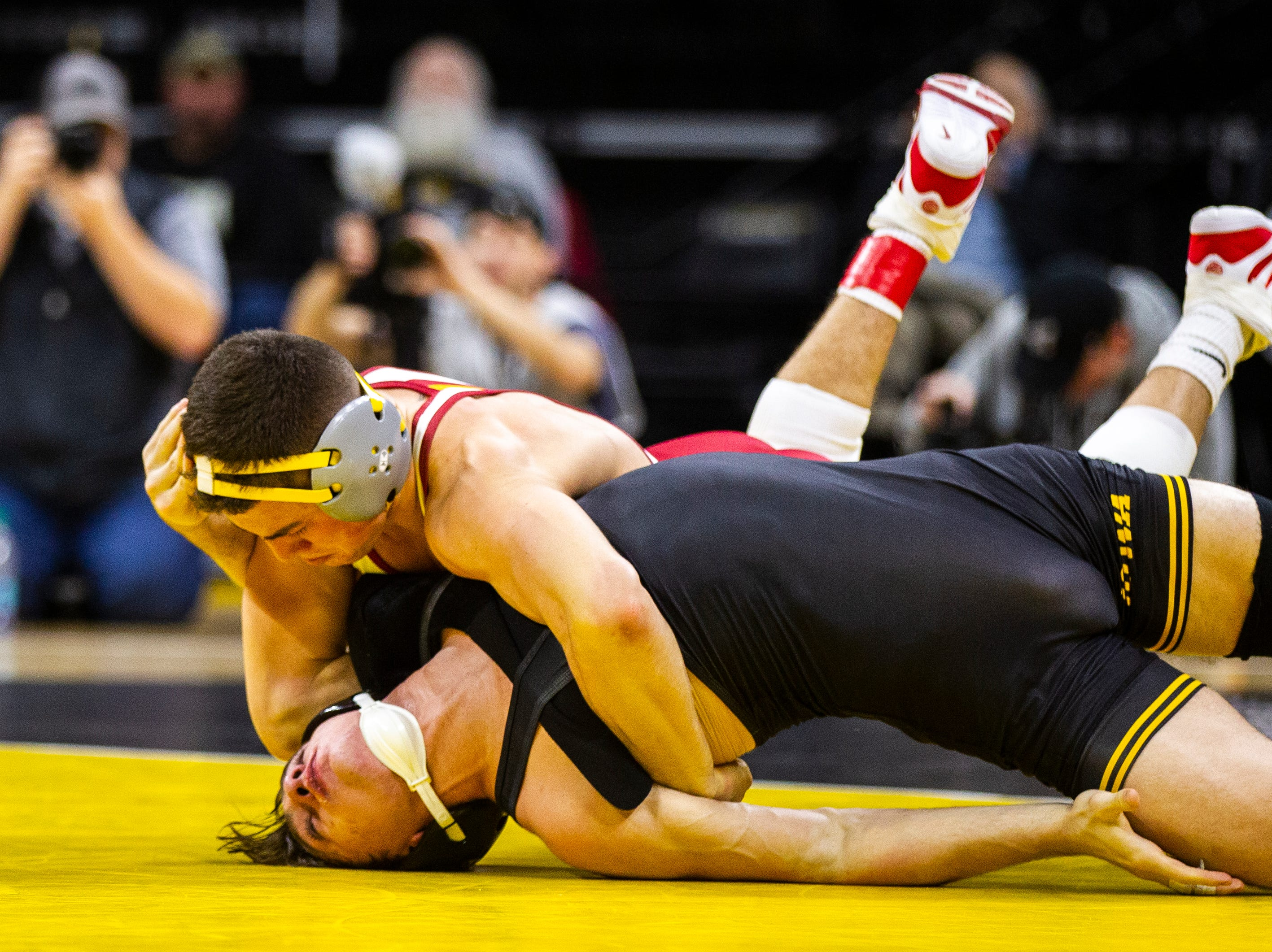 Iowa State's Austin Gomez, left, wrestles Iowa's Austin DeSanto at 133 during a NCAA Cy-Hawk series wrestling dual on Saturday, Dec. 1, 2018, at Carver-Hawkeye Arena in Iowa City.