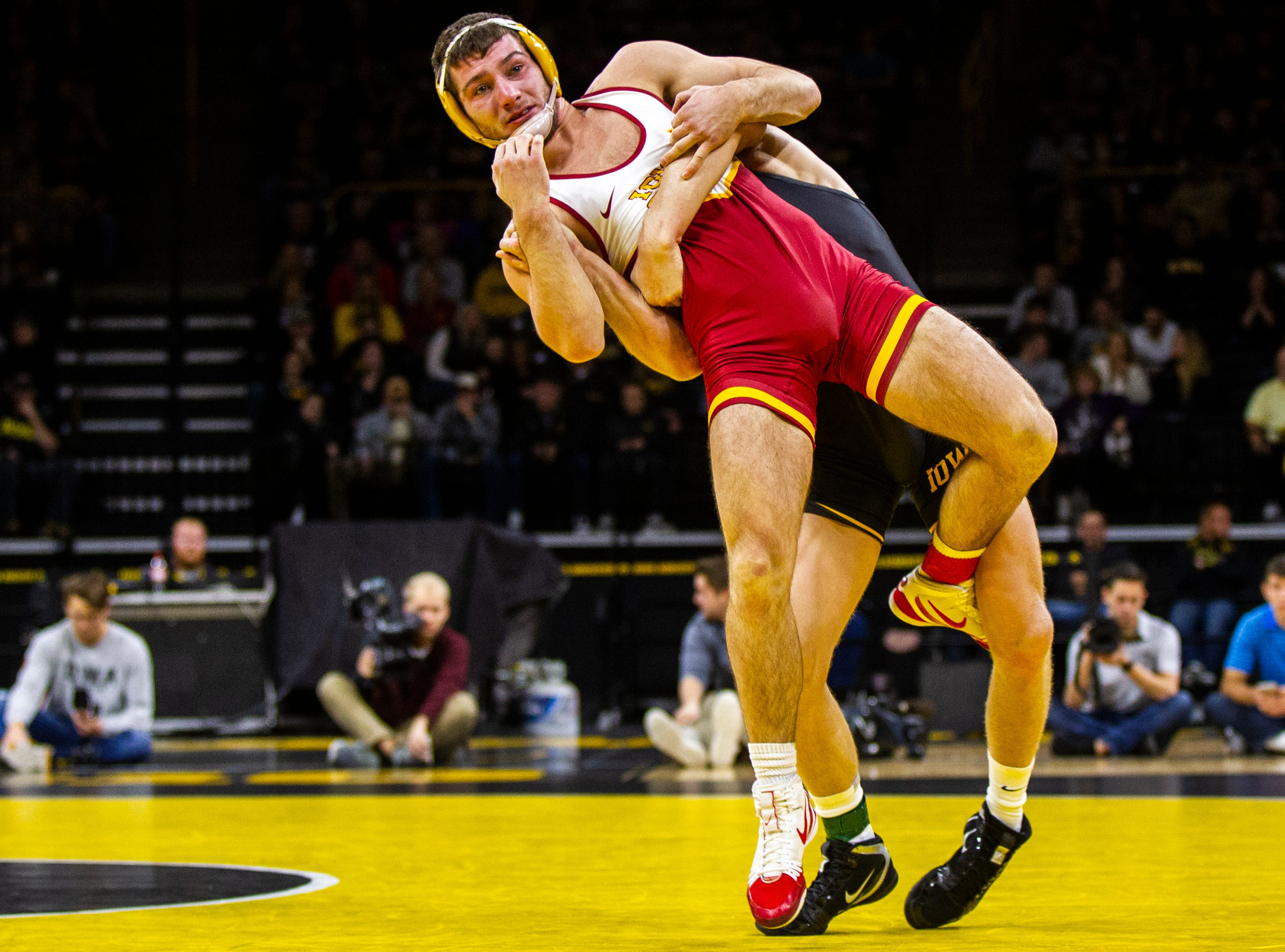 Iowa's Kaleb Young, back, wrestles Iowa State's Chase Straw at 157 during a NCAA Cy-Hawk series wrestling dual on Saturday, Dec. 1, 2018, at Carver-Hawkeye Arena in Iowa City.