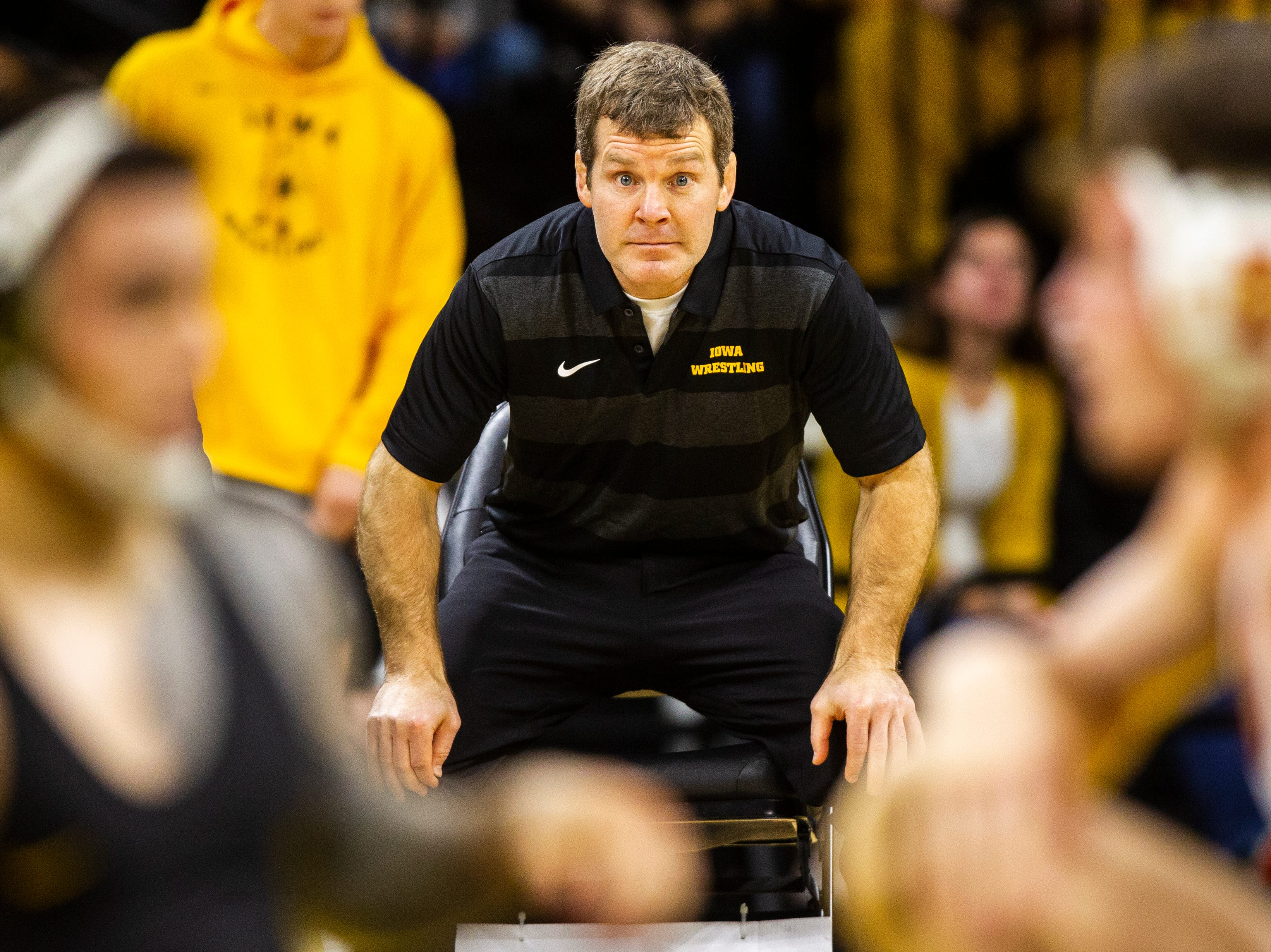 Iowa head coach Tom Brands looks on while Iowa's Pat Lugo wrestles Iowa State's Jarrett Degen at 149 during a NCAA Cy-Hawk series wrestling dual on Saturday, Dec. 1, 2018, at Carver-Hawkeye Arena in Iowa City.
