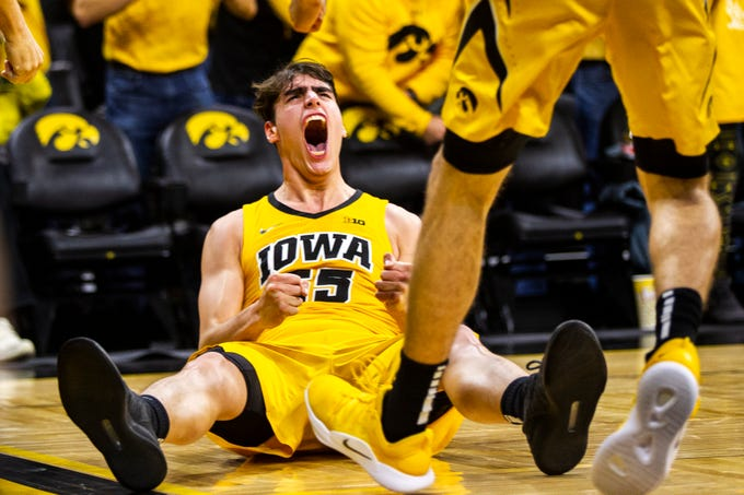 Iowa forward Luka Garza (55) reacts after drawing a foul during a NCAA Big Ten Conference men's basketball game on Friday, Nov. 30, 2018, at Carver-Hawkeye Arena in Iowa City.