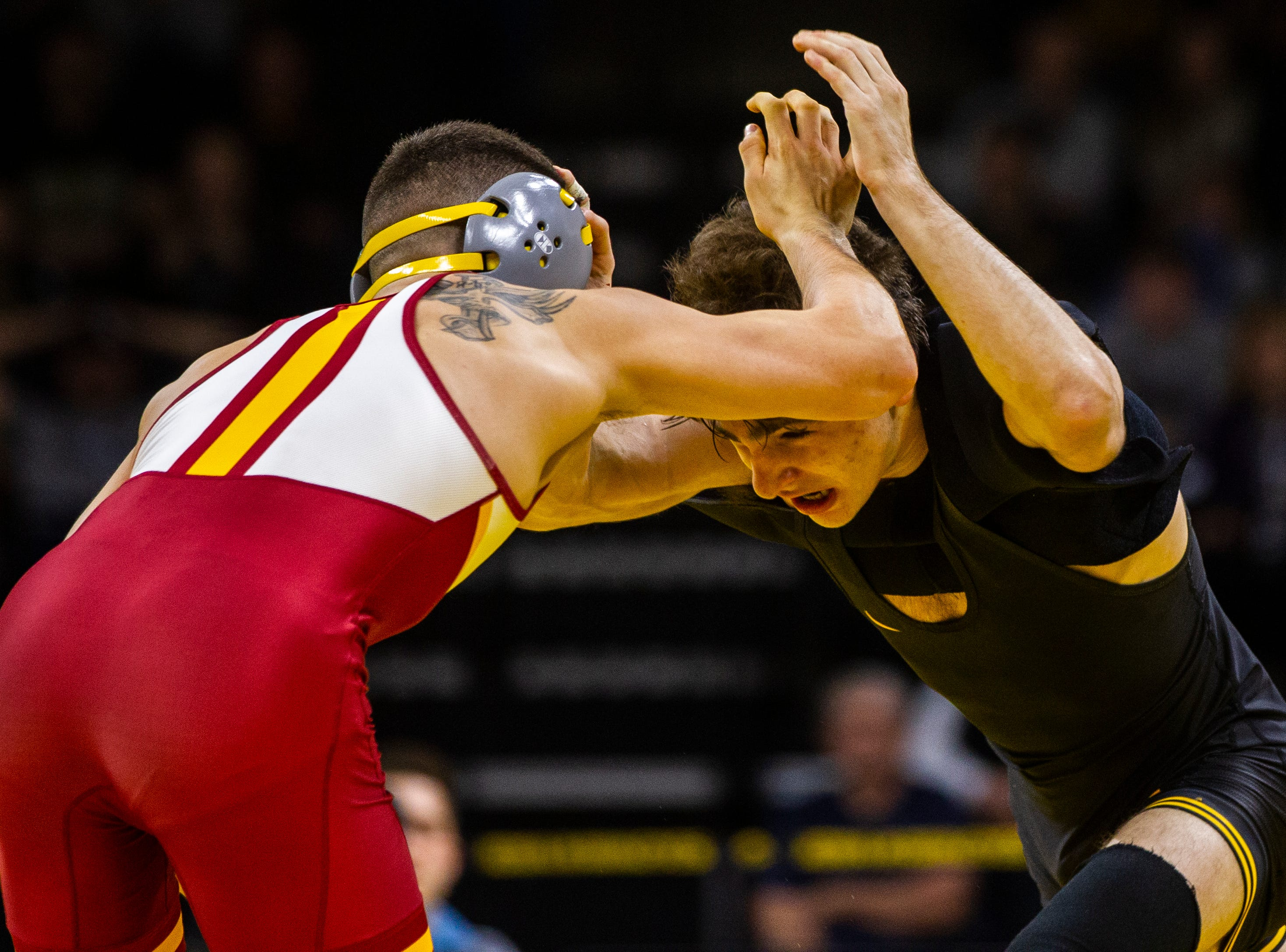Iowa's Austin DeSanto, right, wrestles Iowa State's Austin Gomez at 133 during a NCAA Cy-Hawk series wrestling dual on Saturday, Dec. 1, 2018, at Carver-Hawkeye Arena in Iowa City.