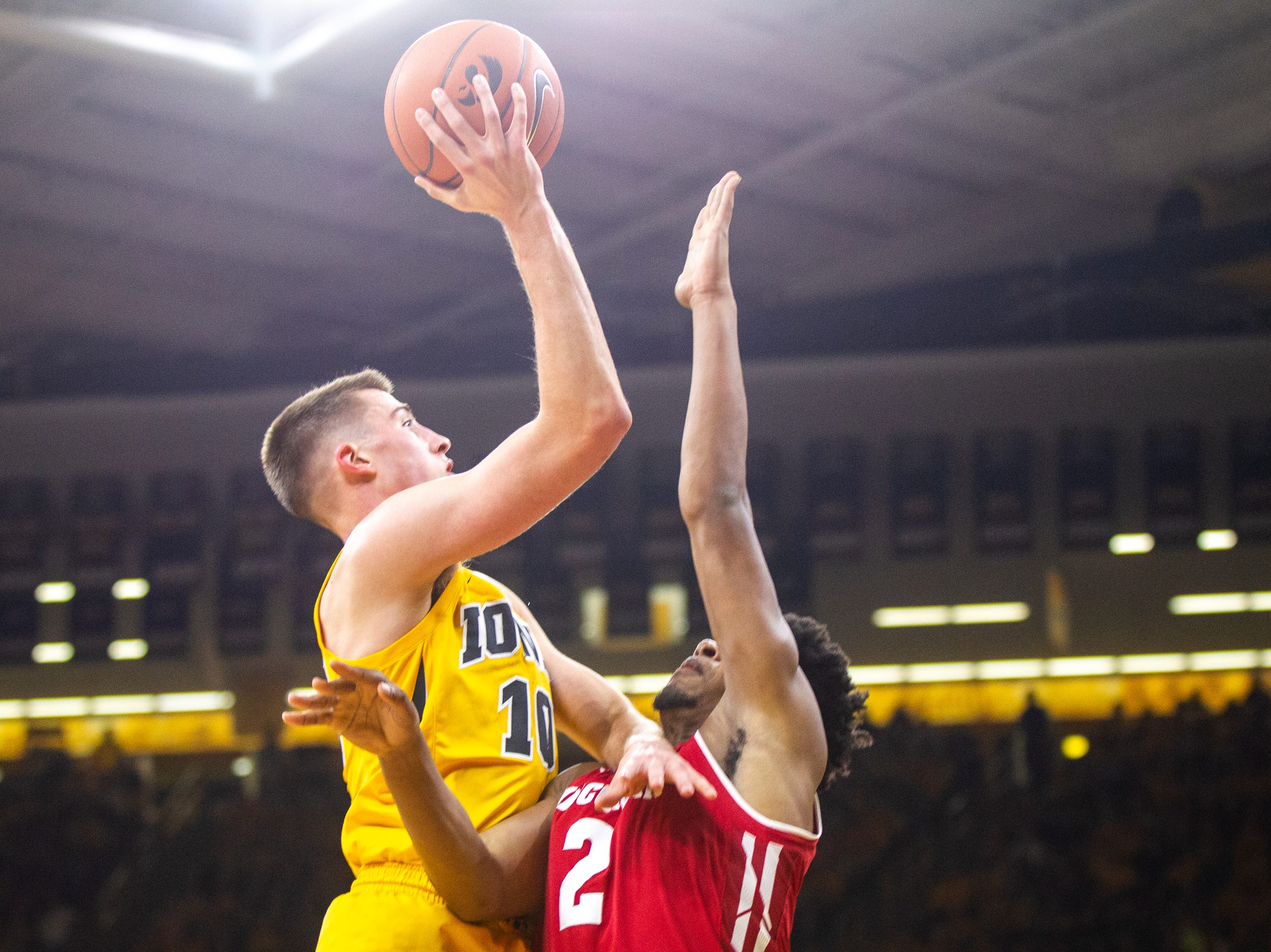 Iowa guard Joe Wieskamp (10) attempts a shot over Wisconsin's Aleem Ford (2) during a NCAA Big Ten Conference men's basketball game on Friday, Nov. 30, 2018, at Carver-Hawkeye Arena in Iowa City.