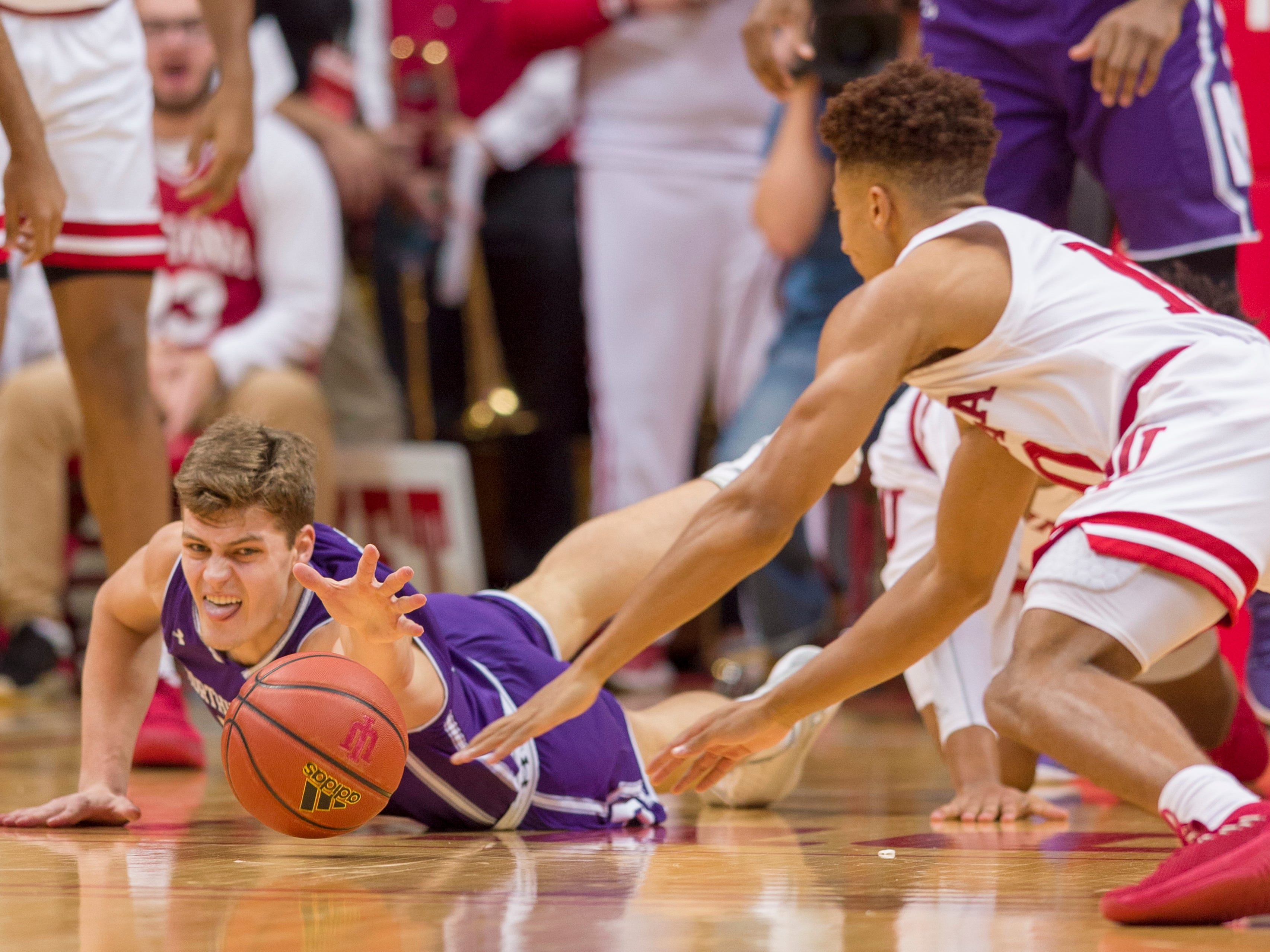 Northwestern forward Miller Kopp (10) dives for the ball after crashing to the floor during the first half of an NCAA college basketball game against Indiana Saturday, Dec. 1, 2018, in Bloomington, Ind.