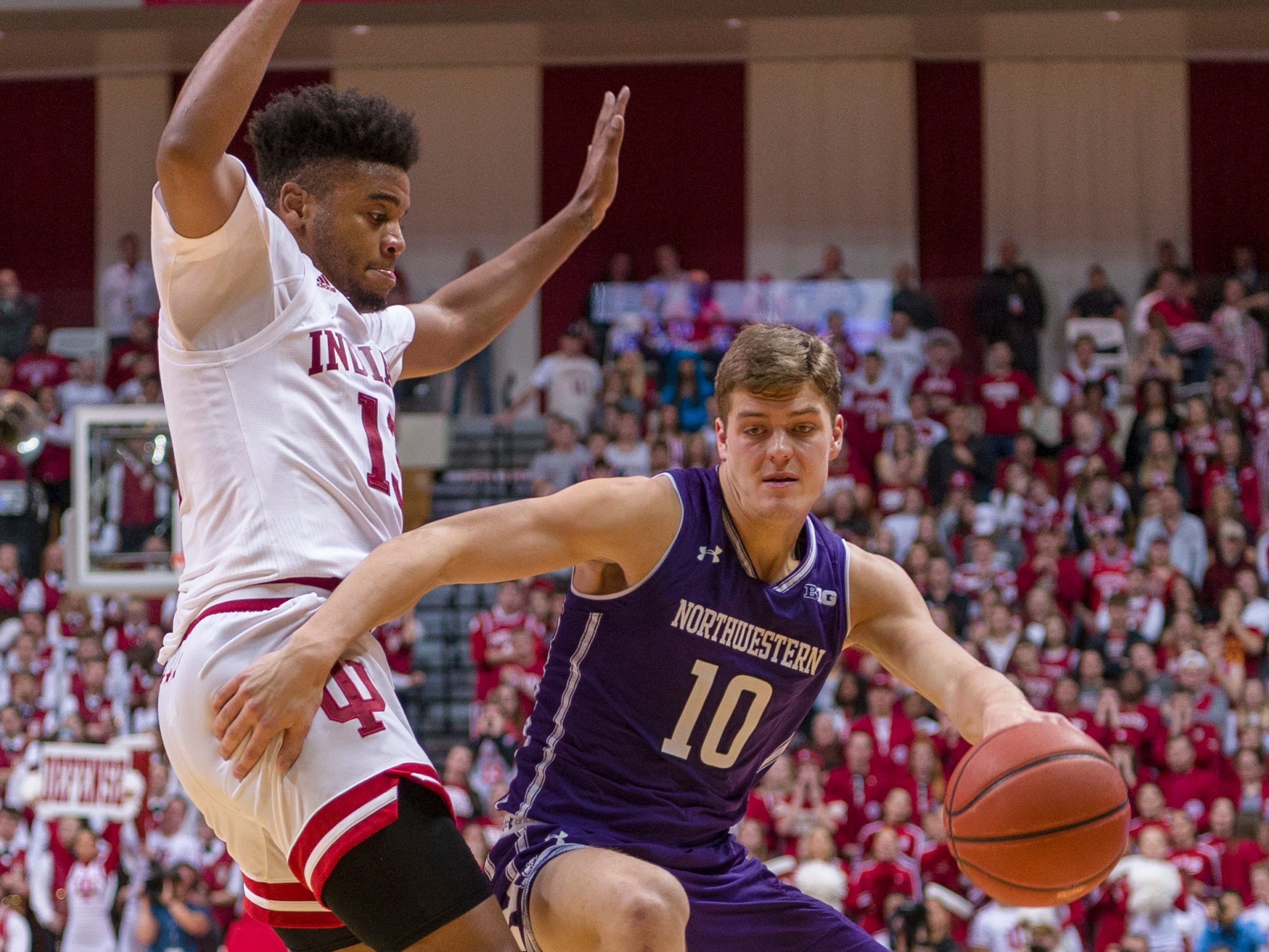 Northwestern forward Miller Kopp (10) makes a move around the defense of Indiana forward Juwan Morgan (13) during the first half of an NCAA college basketball game Saturday, Dec. 1, 2018, in Bloomington, Ind.