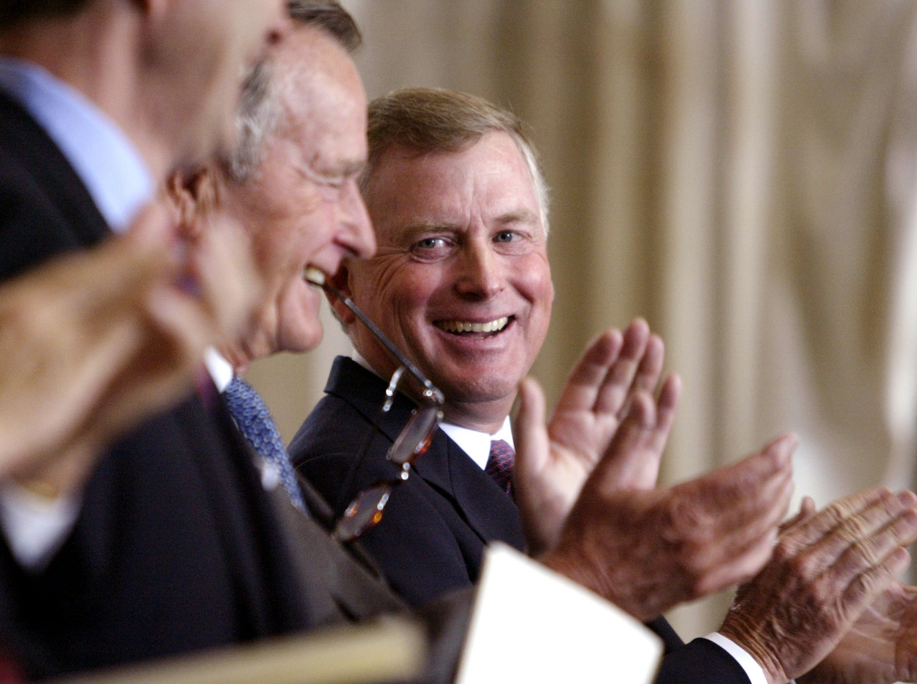 President George H. W. Bush and Vice President Dan Quayle attend a ceremony at the U.S. Capitol on Sept. 10, 2003, for the unveiling of a bust of the former vice president.