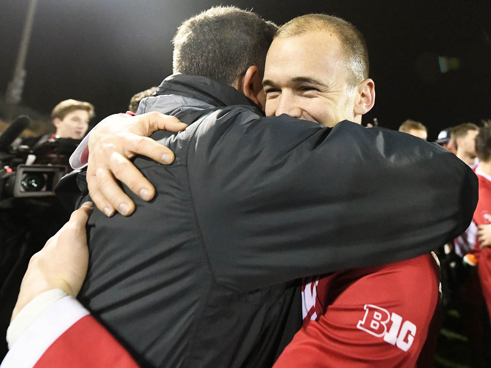Indiana Hoosiers head coach Todd Yeagley (left) and Indiana Hoosiers defender Andrew Gutman (15) hug after winning the NCAA quarterfinal match against Notre Dame at Bill Armstrong Stadium in Bloomington Ind., on Friday, Nov. 30, 2018.