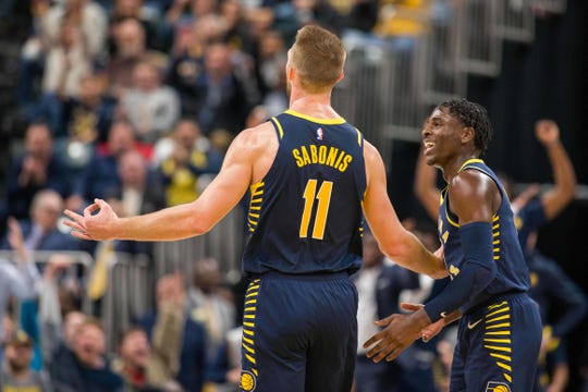 Pacers forward Domantas Sabonis (11) celebrates a three point basket in the second half against the Utah Jazz at Bankers Life Fieldhouse.
