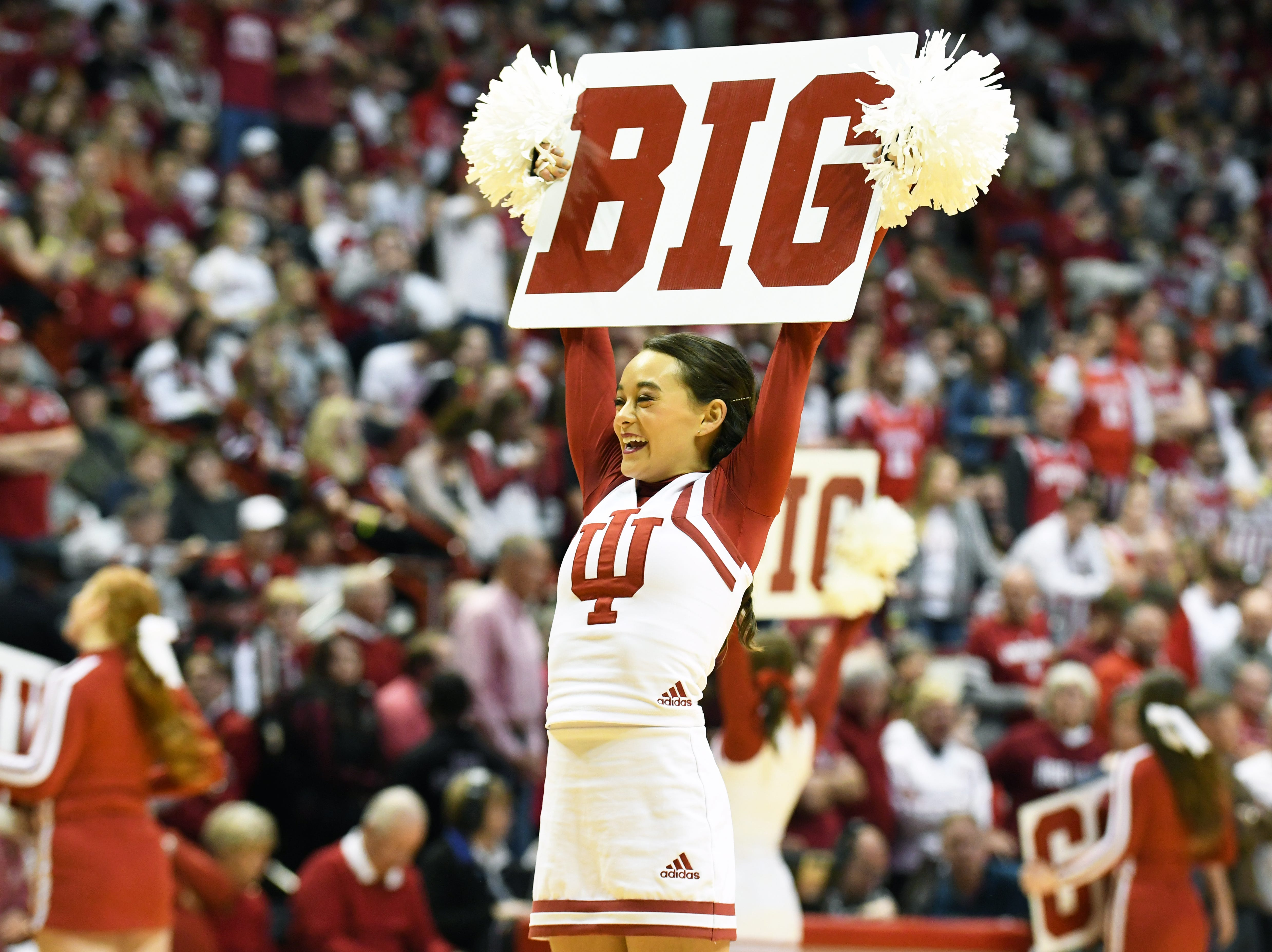 An Indiana Hoosiers cheerleader cheers during the game against Northwestern at Simon Skjodt Assembly Hall in Bloomington, Ind., on Saturday, Dec. 1, 2018.