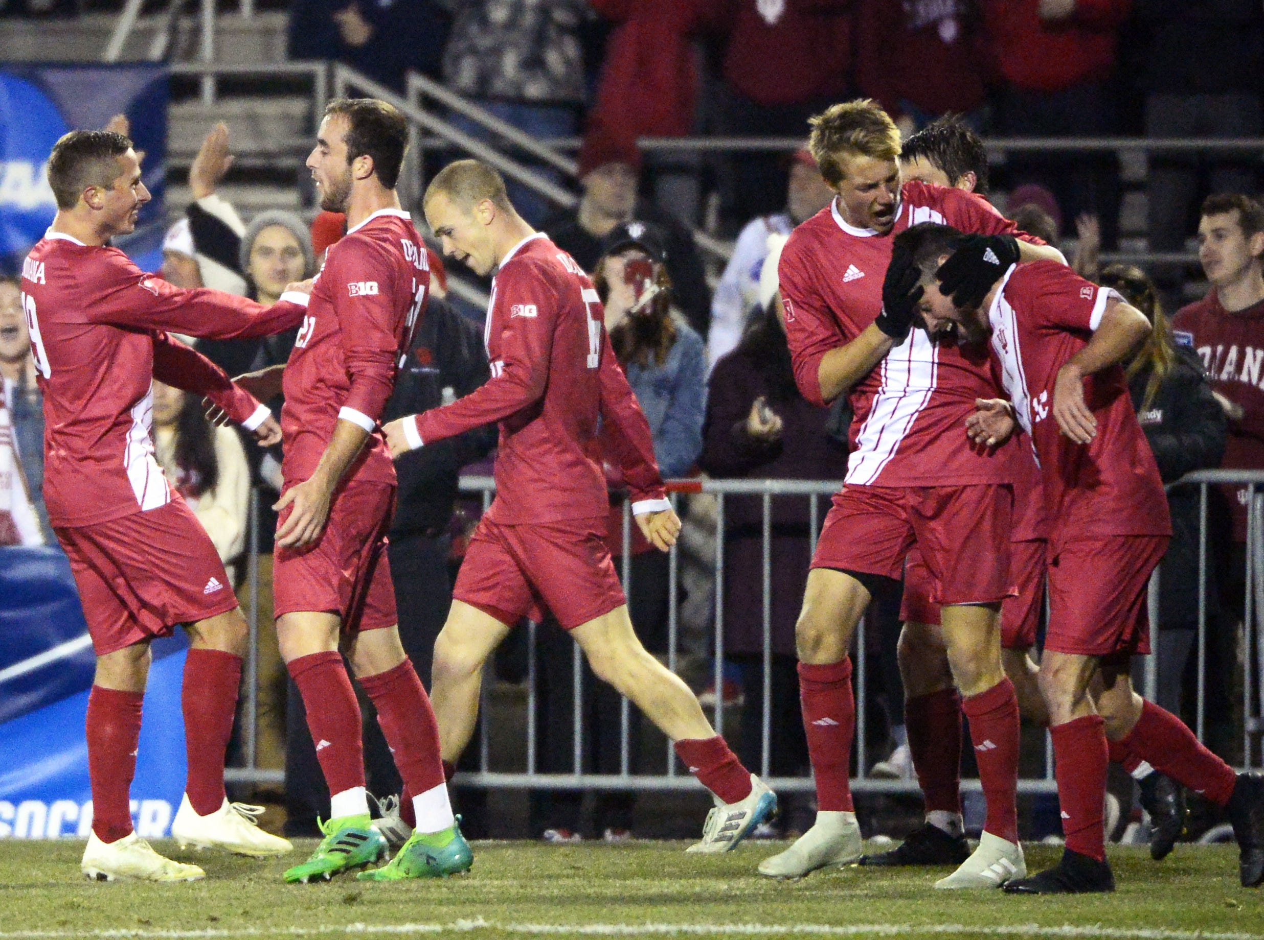 The Indiana Hoosiers celebrate after scoring a goal during the NCAA quarterfinal match against Notre Dame at Bill Armstrong Stadium in Bloomington Ind., on Friday, Nov. 30, 2018.
