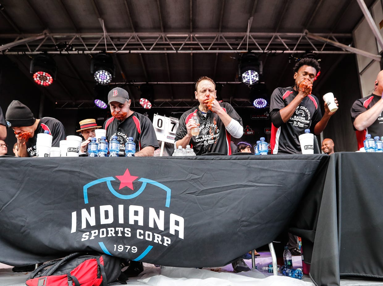 Major League Eaters compete during the sixth annual World Famous St. Elmo Shrimp Cocktail Eating Championship, held during the Meijer Tailgate Party on Georgia St. in Indianapolis on Saturday, Dec. 1, 2018. during the sixth annual World Famous St. Elmo Shrimp Cocktail Eating Championship, held during the Meijer Tailgate Party on Georgia St. in Indianapolis on Saturday, Dec. 1, 2018.