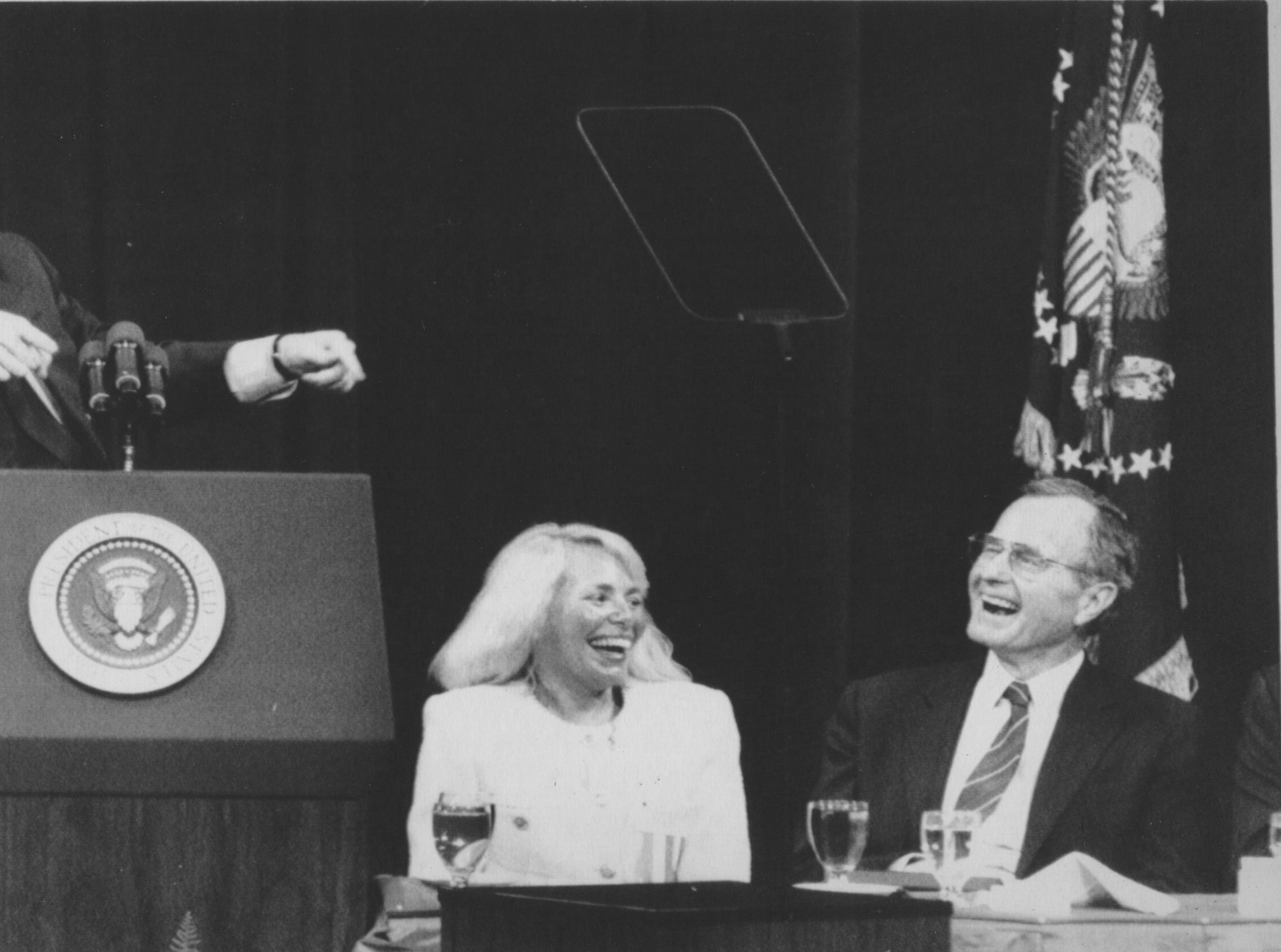 Comedian Fred Travalena, left, gets a laugh from President George H .W. Bush and Nancy Irsay during the president's April 4, 1990, Indianapolis visit. Bush was in town to attend an urban tree planting ceremony. He campaigned for Sen. Dan Coats, who was appointed to fill the spot Dan Quayle left vacant when elected vice-president.
