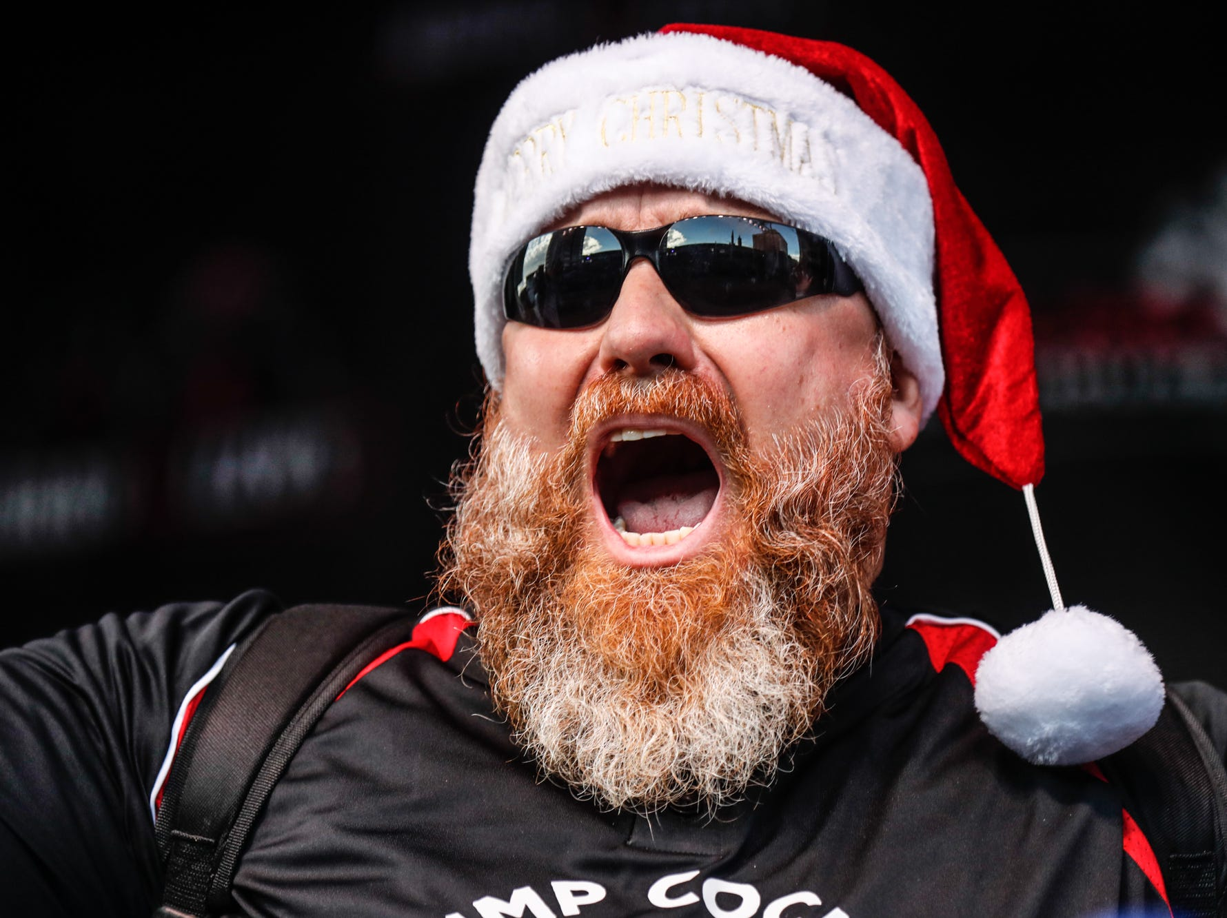 Major League Eater, Matthew Raible takes the stage, during the sixth annual World Famous St. Elmo Shrimp Cocktail Eating Championship, held during the Meijer Tailgate Party on Georgia St. in Indianapolis on Saturday, Dec. 1, 2018.