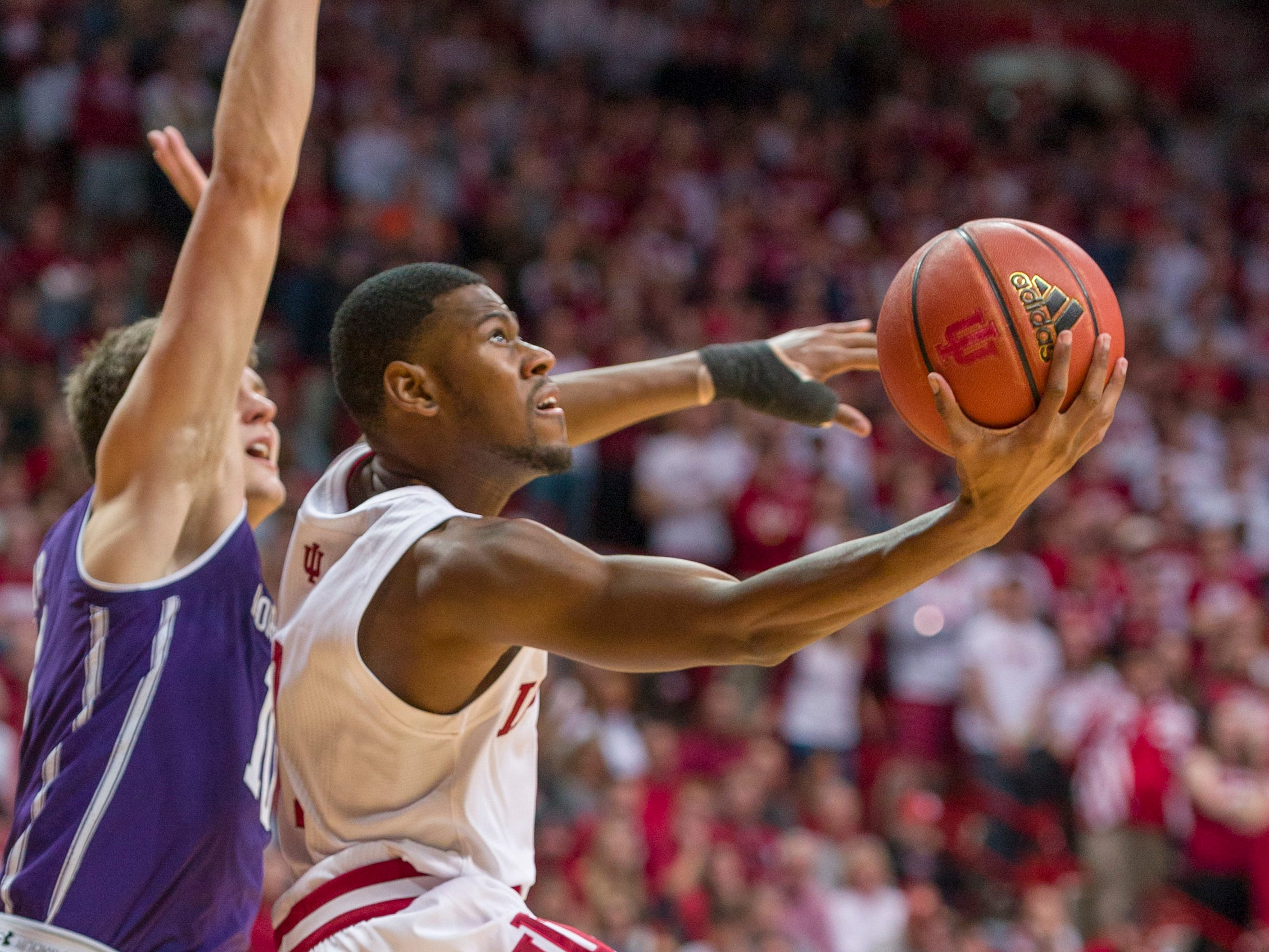 Indiana guard Aljami Durham (1) drives the ball to the basket from the baseline during the second half of an NCAA college basketball game against Northwestern Saturday, Dec. 1, 2018, in Bloomington, Ind. Indiana won 68-66.