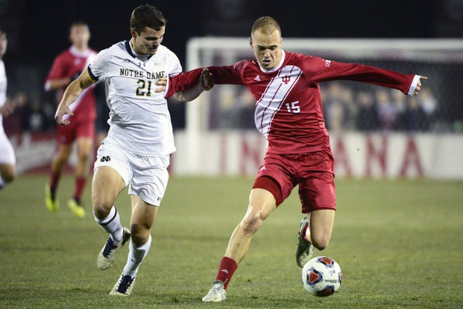 Indiana Hoosiers defender Andrew Gutman (15) dribbles the ball during the NCAA quarterfinal match against Notre Dame at Bill Armstrong Stadium in Bloomington Ind., on Friday, Nov. 30, 2018.