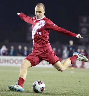 Indiana Hoosiers defender Andrew Gutman (15) kicks the ball during the NCAA quarterfinal match against Notre Dame at Bill Armstrong Stadium in Bloomington Ind., on Friday, Nov. 30, 2018.