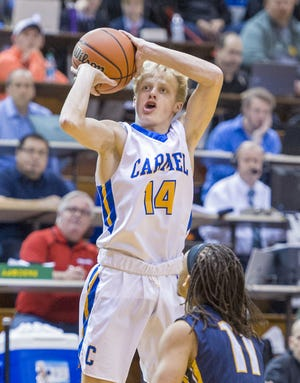 FILE – Carmel's Karsten Windlan had a big game to lead the Greyhounds over Lawrence Central.