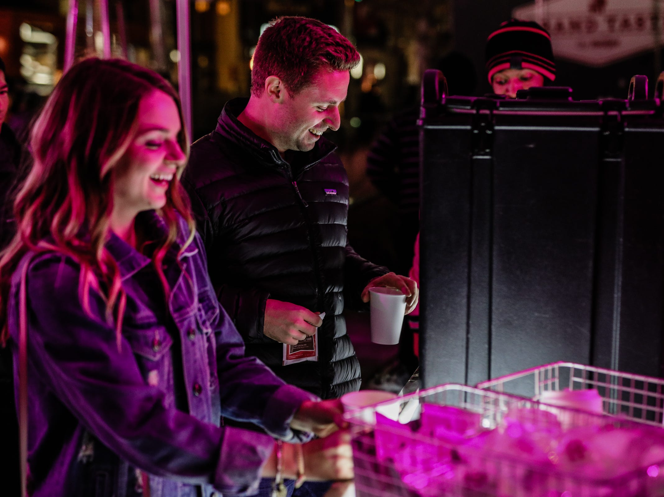 People line up to get hot chocolate during the Georgia Street Preshow Tailgate