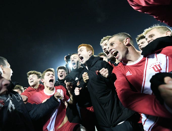 The Indiana Hoosiers celebrate after winning the NCAA quarterfinal match against Notre Dame at Bill Armstrong Stadium in Bloomington Ind., on Friday, Nov. 30, 2018.