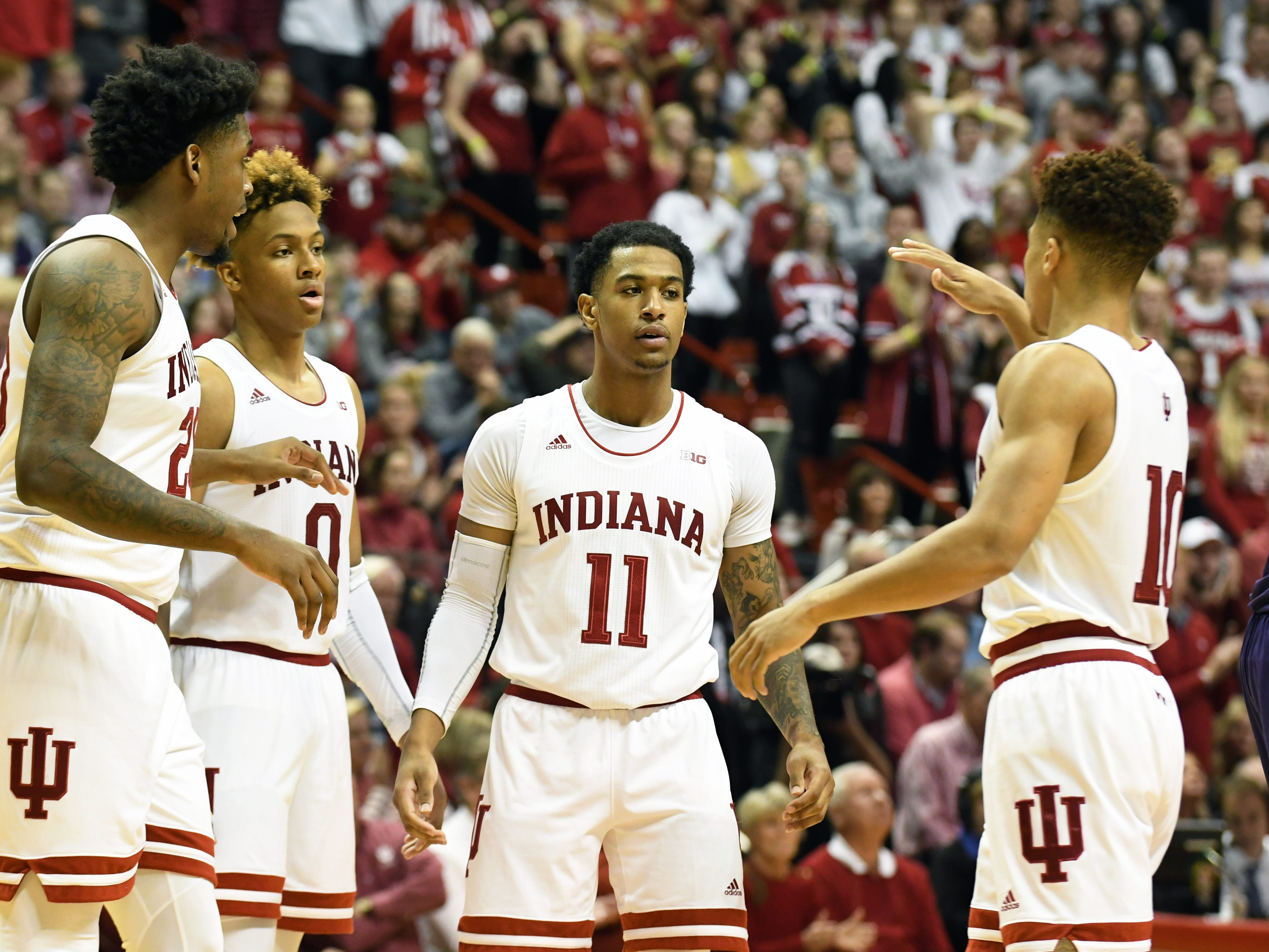 The Indiana Hoosiers celebrate after a play during the game against Northwestern at Simon Skjodt Assembly Hall in Bloomington, Ind., on Saturday, Dec. 1, 2018.