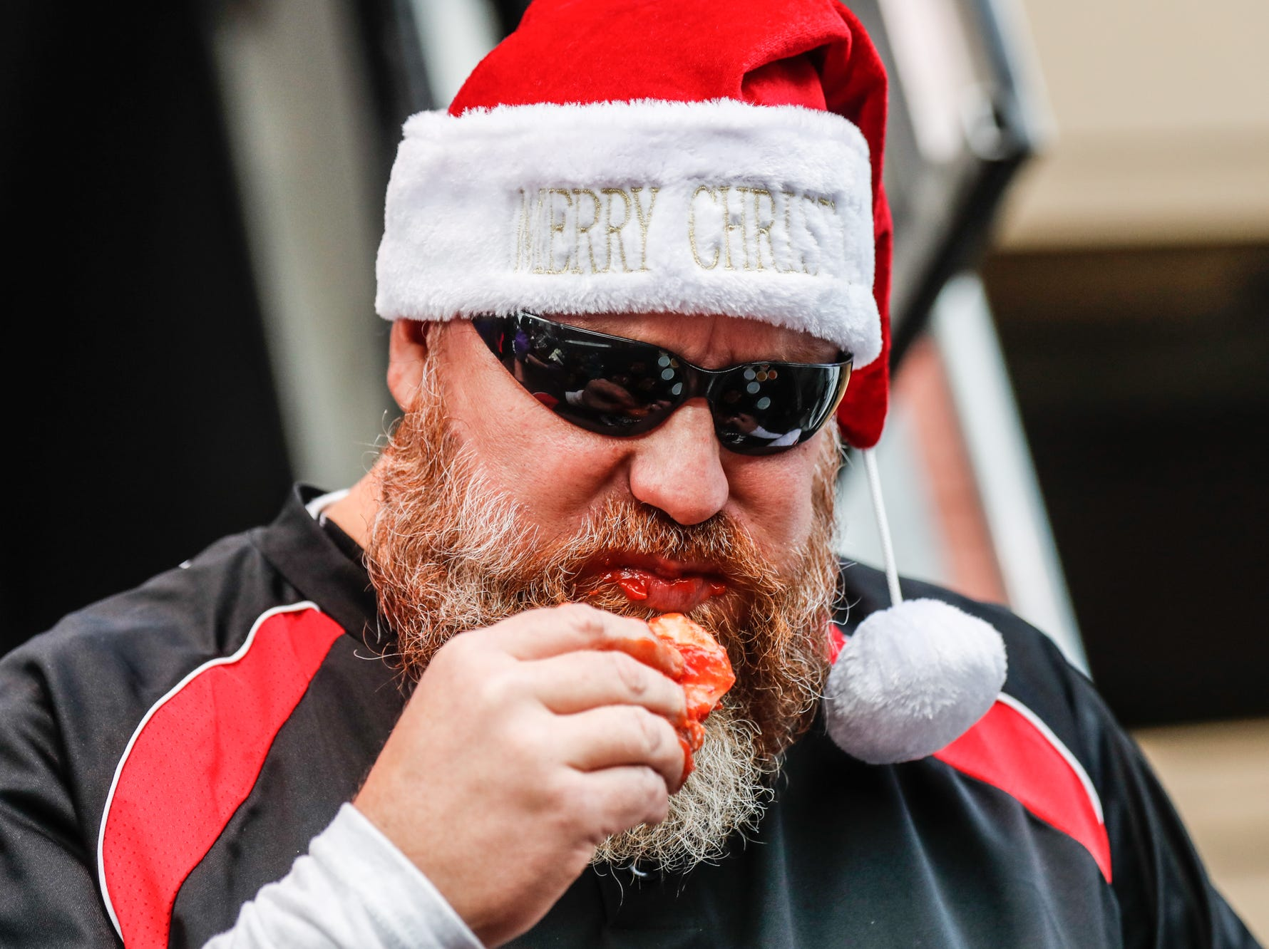 Major League Eater, Matthew Raible competes in the sixth annual World Famous St. Elmo Shrimp Cocktail Eating Championship, held during the Meijer Tailgate Party on Georgia St. in Indianapolis on Saturday, Dec. 1, 2018.