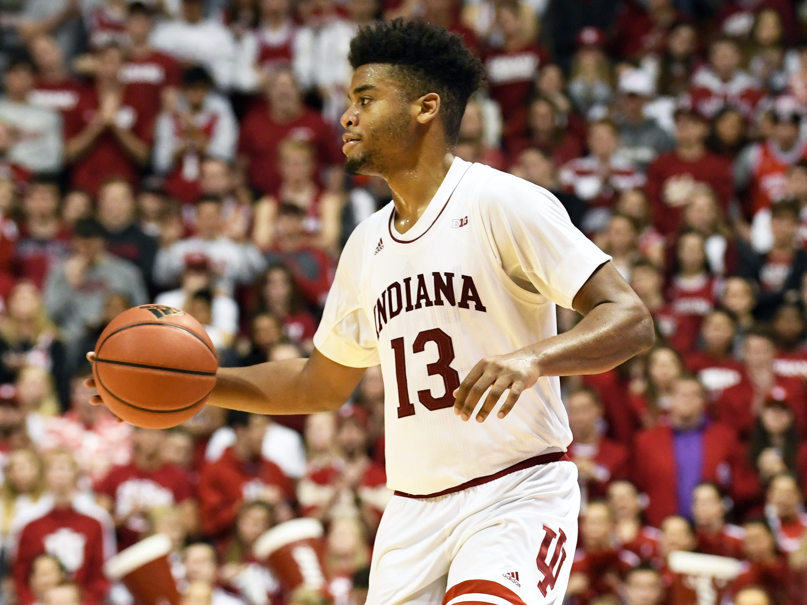 Indiana Hoosiers forward Juwan Morgan (13) brings the ball up the court during the game against Northwestern at Simon Skjodt Assembly Hall in Bloomington, Ind., on Saturday, Dec. 1, 2018.