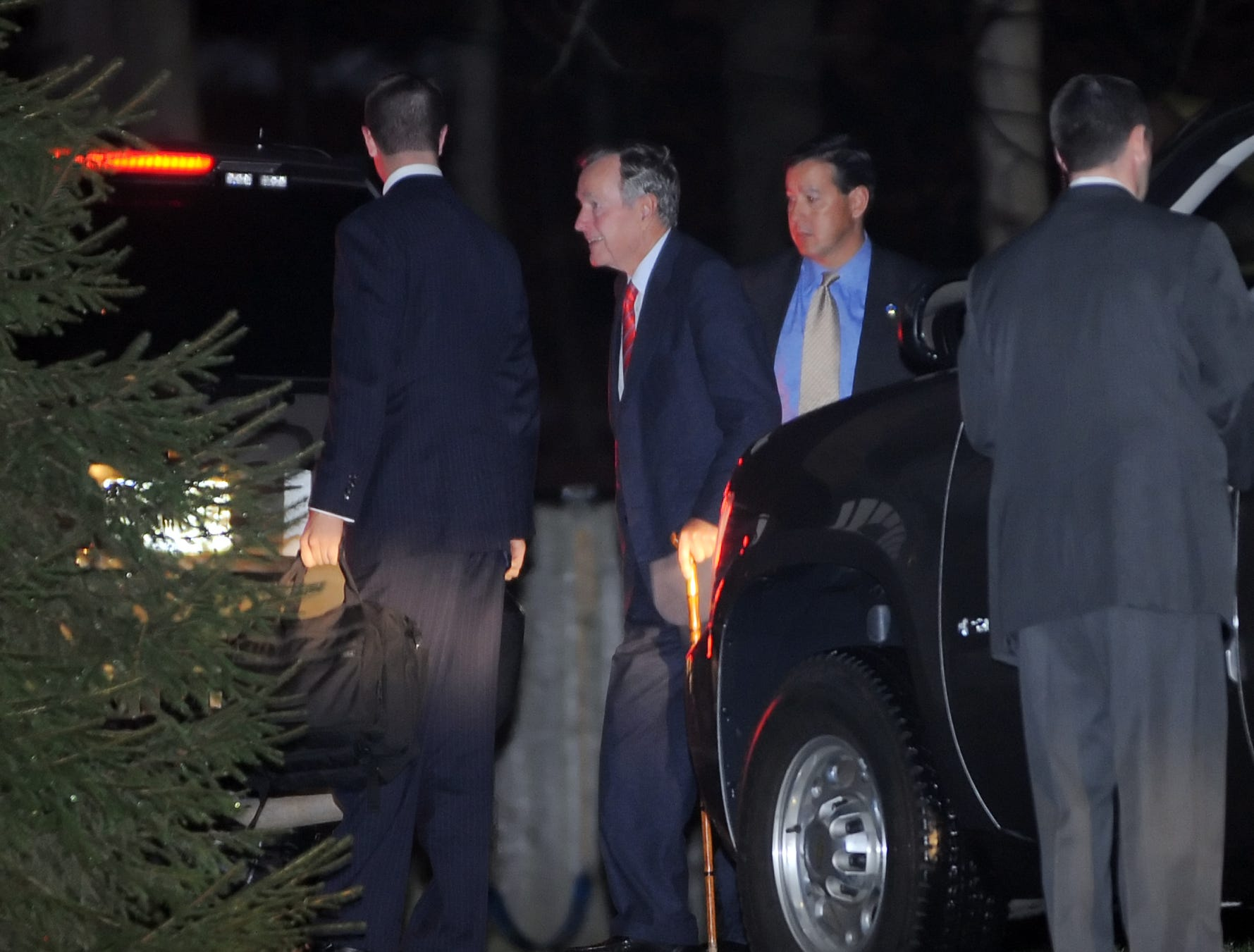 Former President George H.W. Bush is greeted as he arrives at 4270 N Meridian St. for a charity event to benefit Alzheimer's research in this undated photo.