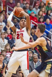 Center Grove senior Trayce Jackson-Davis (23) puts up a shot during the first half against Cathedral.