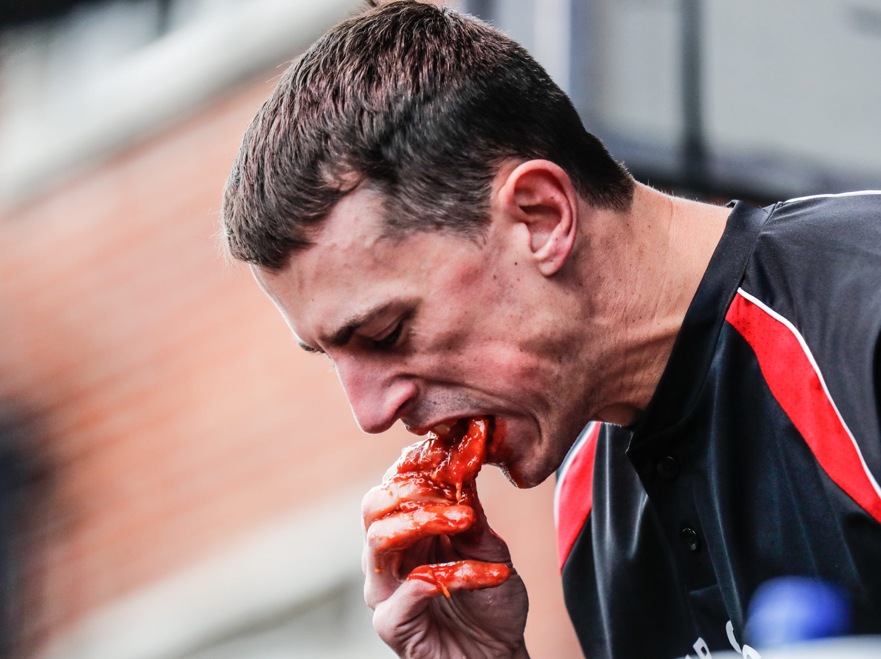 Major League Eater, Derek Jacobs competes in the sixth annual World Famous St. Elmo Shrimp Cocktail Eating Championship, held during the Meijer Tailgate Party on Georgia St. in Indianapolis on Saturday, Dec. 1, 2018.